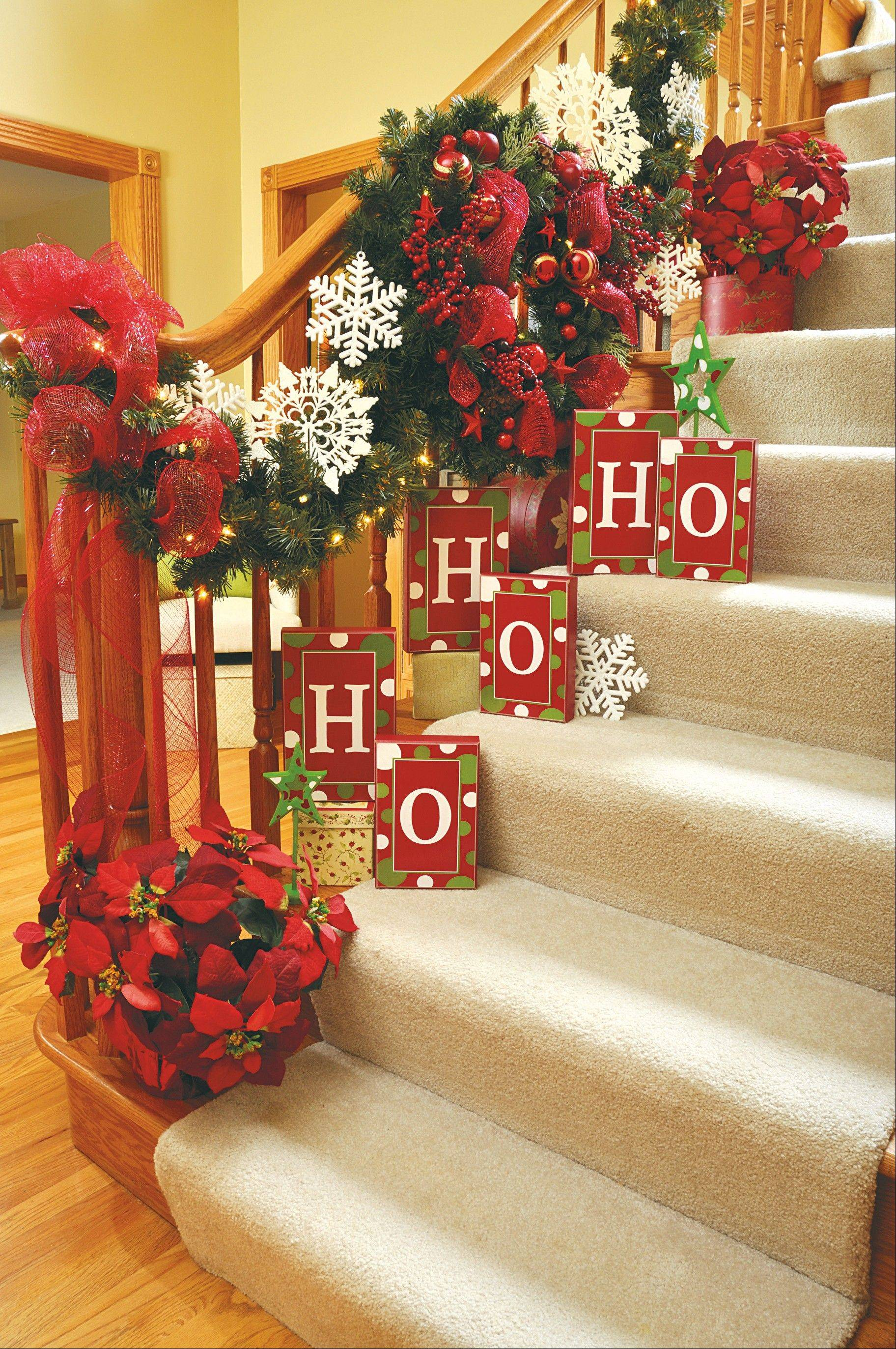 Alphabet bricks arranged on a staircase is a fanciful way of greeting holiday guests.