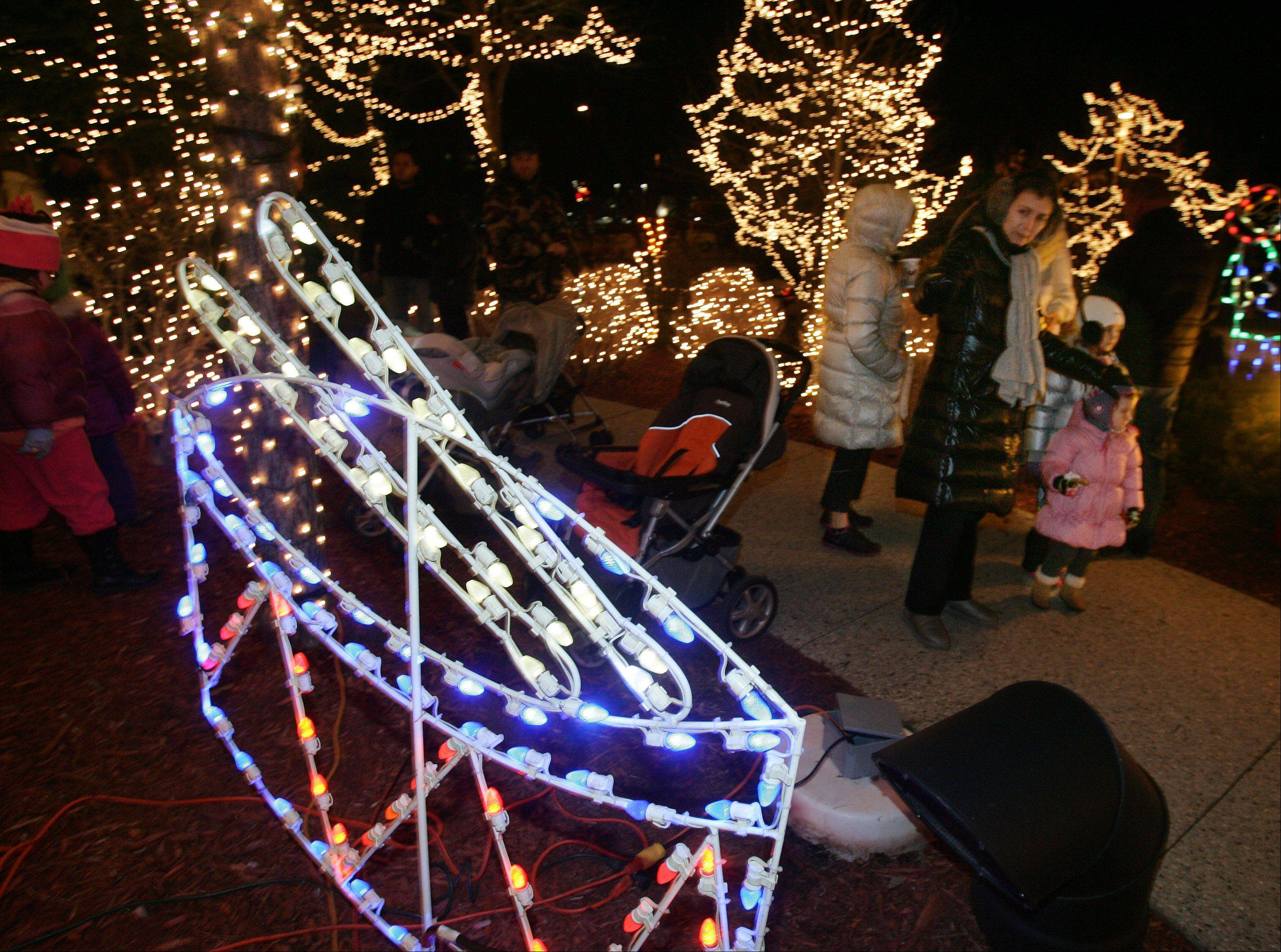 Families view the light decorations during Wheeling�s Lighting of the Lights Sunday at Friendship Park.