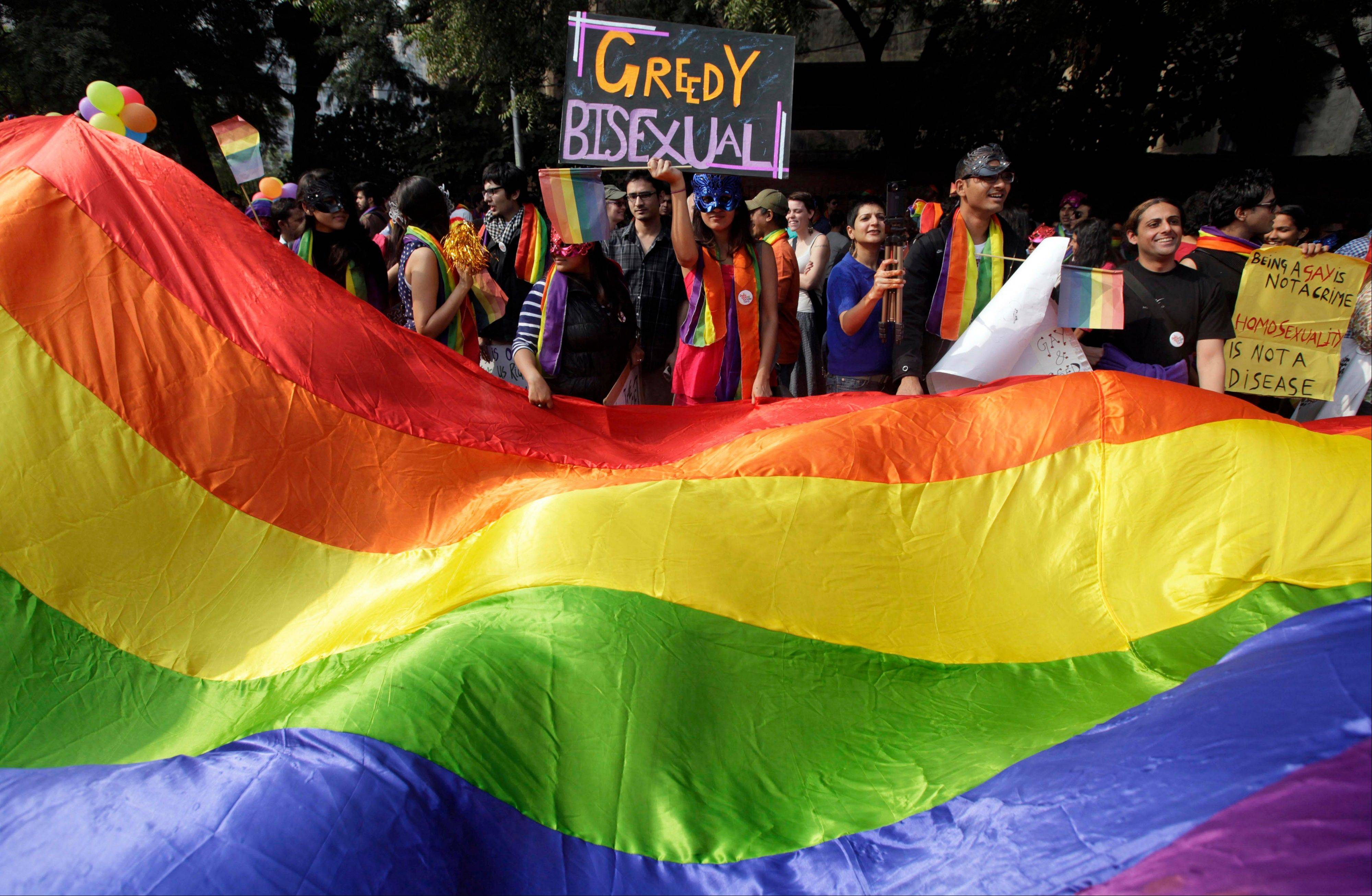 Demonstrators carry a banner Sunday at a gay pride parade in New Delhi, India. Until 2009, gay sex was punishable by up to 10 years in prison in India.