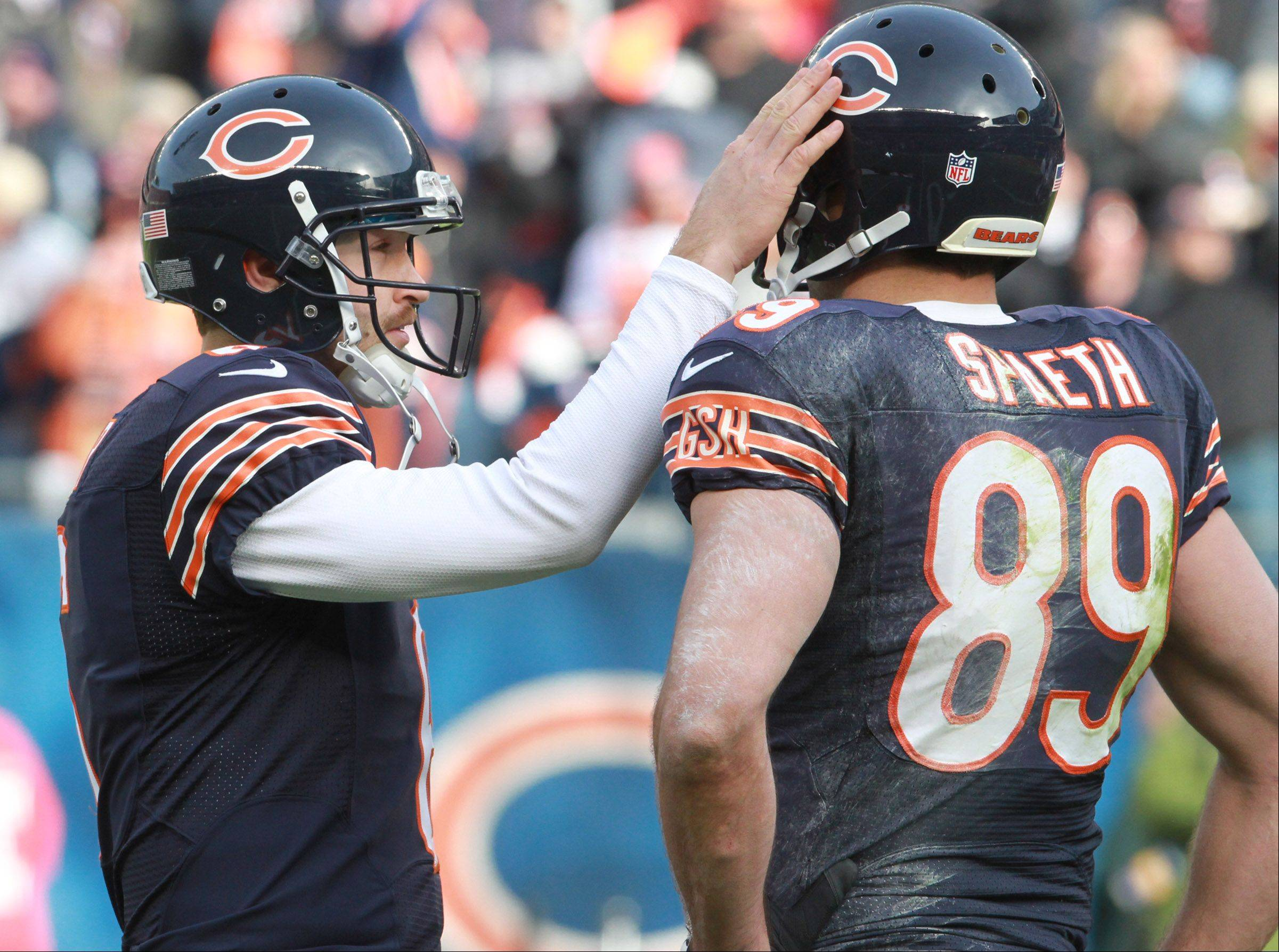 Chicago Bears quarterback Jay Cutler gives Chicago Bears tight end Matt Spaeth a hand after Spaeth scores a touchdown Soldier Field Sunday.
