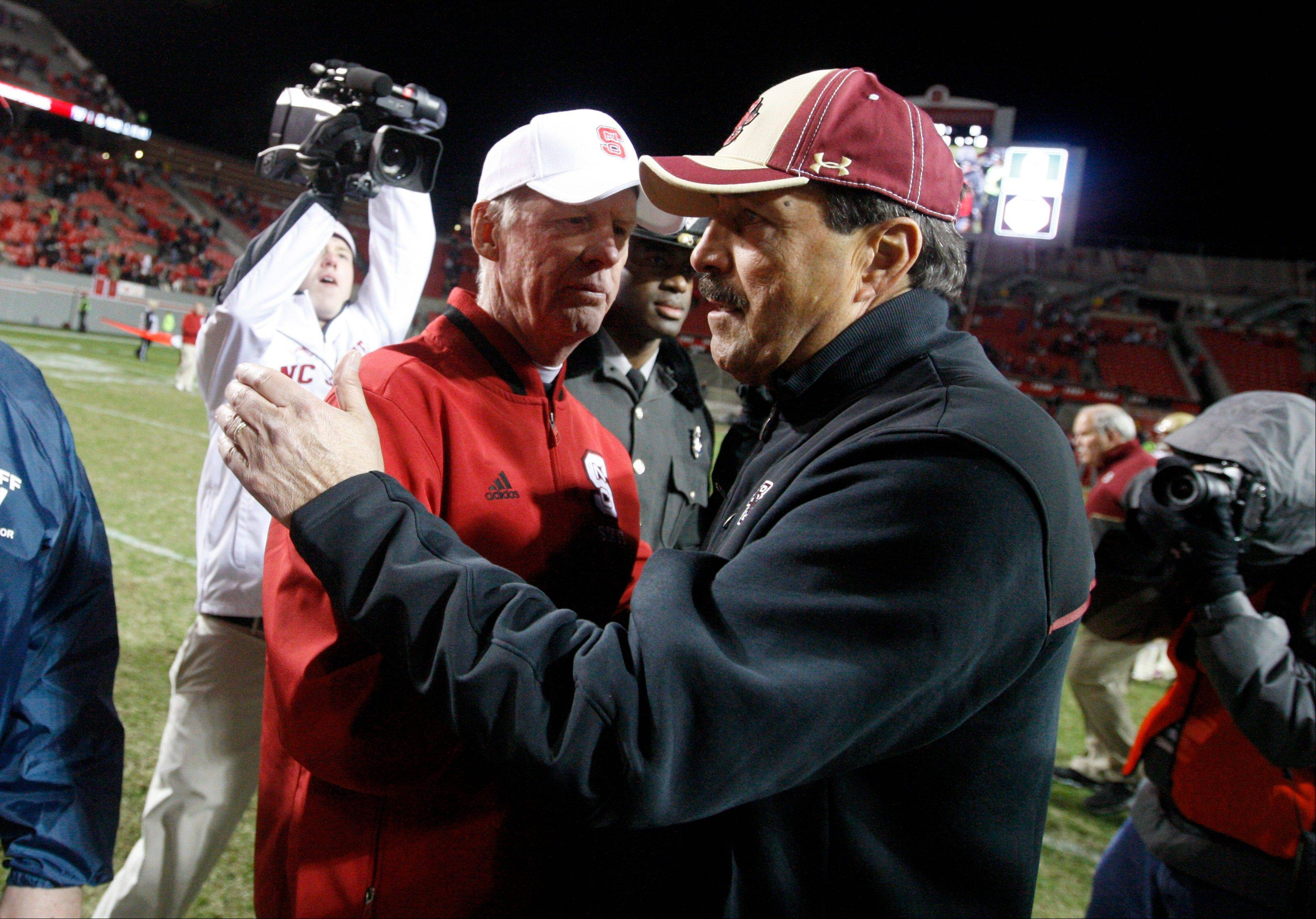 North Carolina State coach Tom O�Brien, left, greets Boston College coach Frank Spaziani after N.C. State�s 27-10 victory on Saturday. Both coaches lost their jobs Sunday.