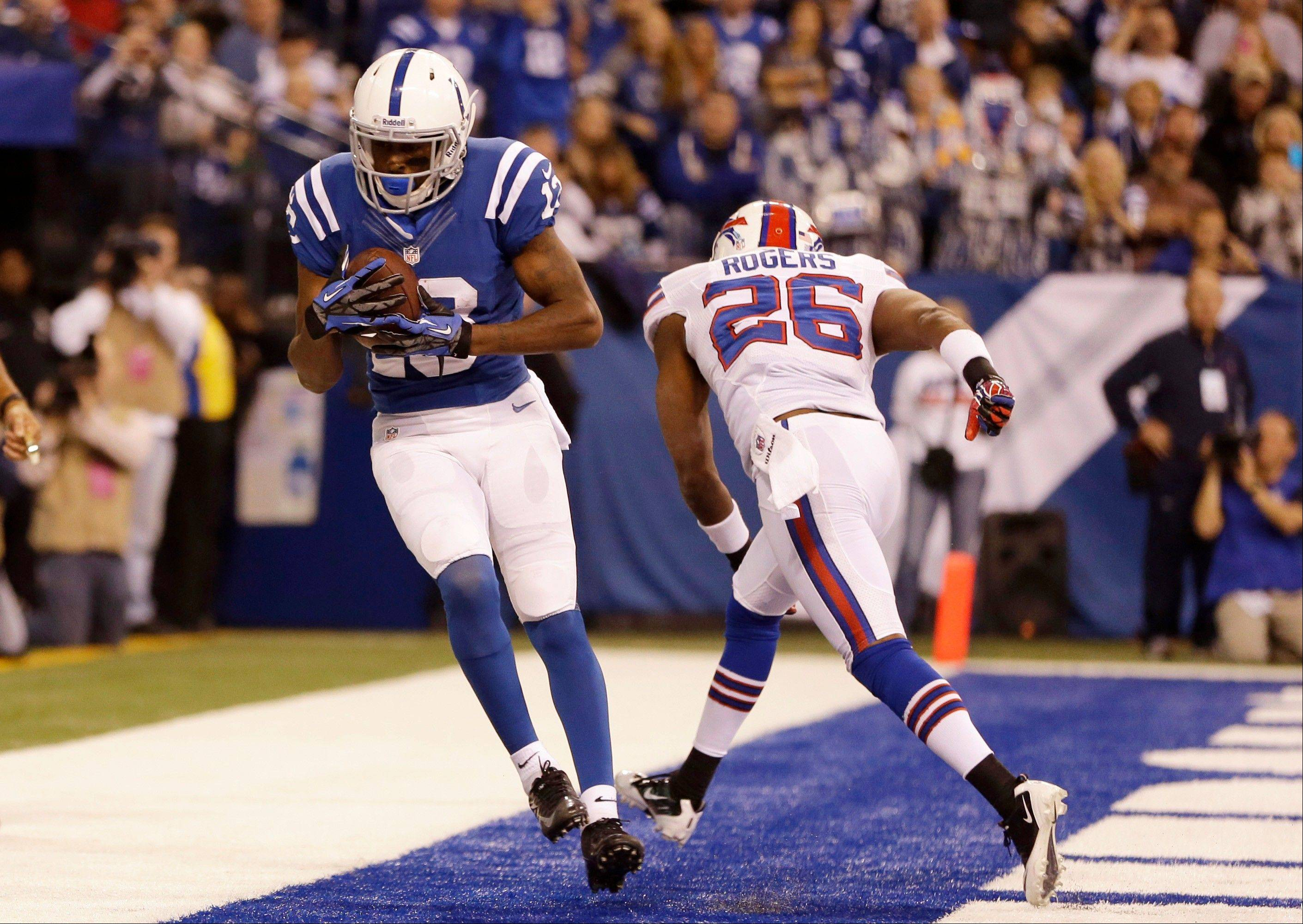 Colts wide receiver T.Y. Hilton, left, makes a catch in the end zone in front of Buffalo Bills defensive back Justin Rogers for a touchdown during the second half Sunday in Indianapolis.