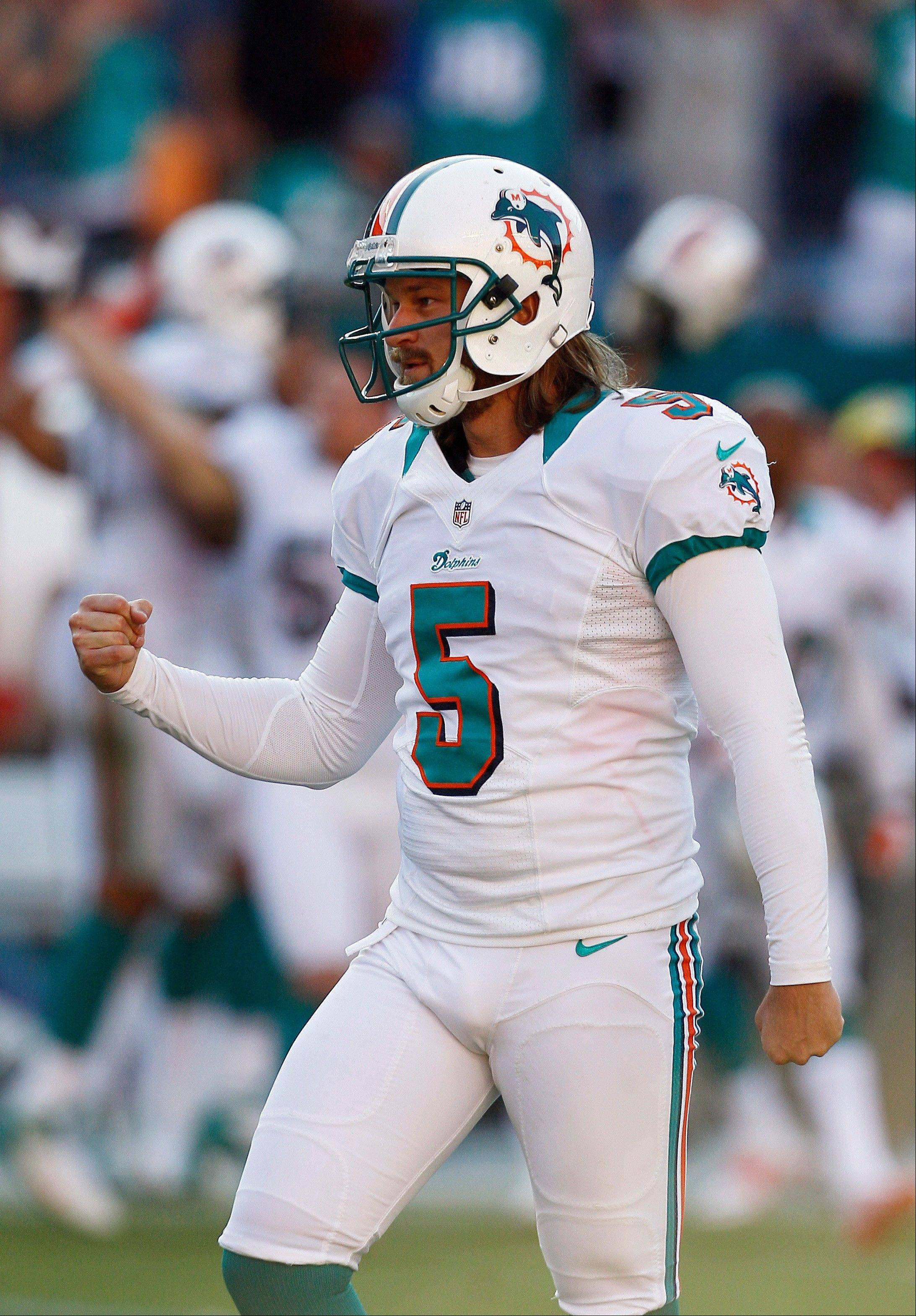 Miami kicker Dan Carpenter celebrates his game-winning field goal against Seattle on Sunday at home.