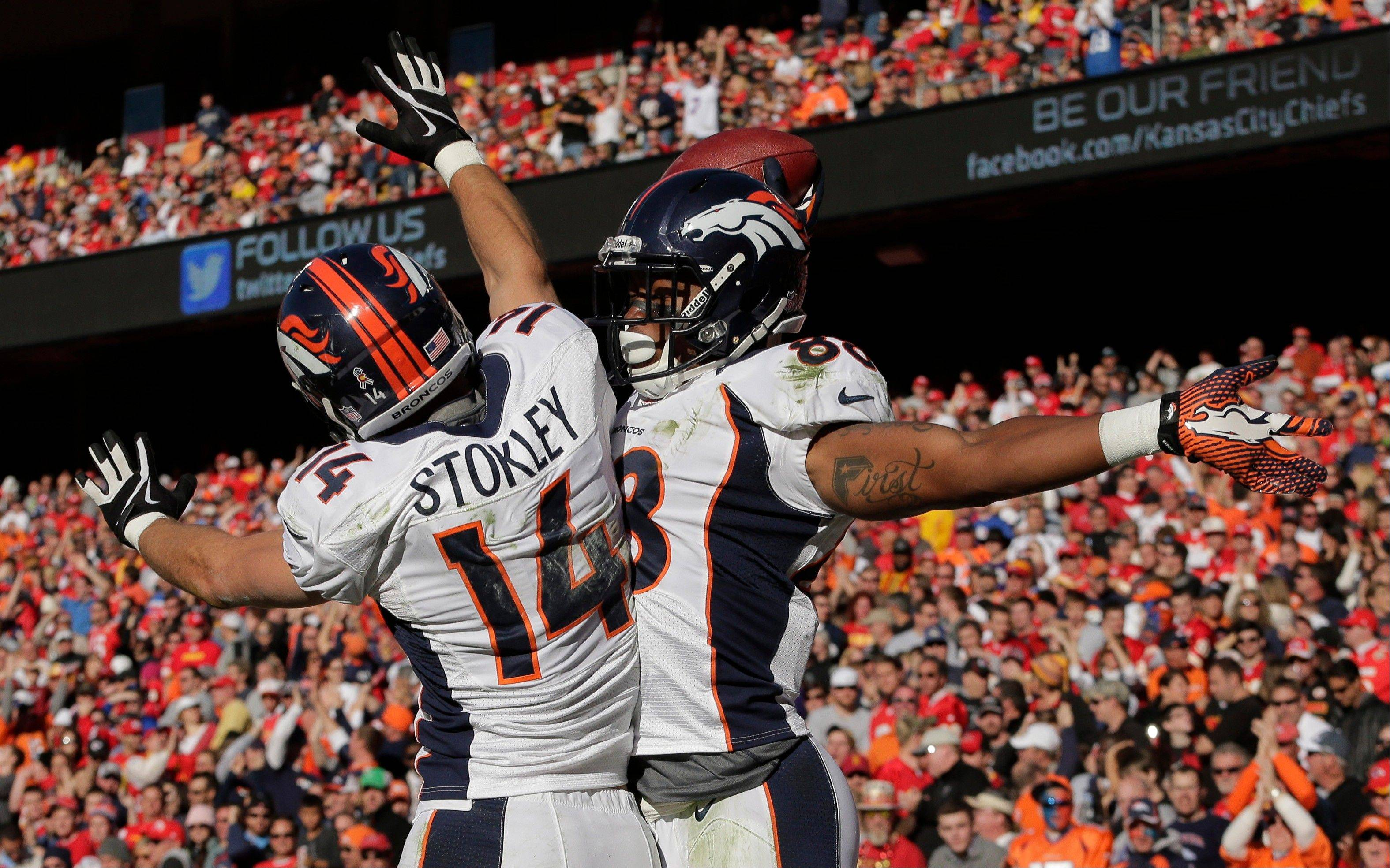 Denver Broncos wide receivers Demaryius Thomas (88) and Brandon Stokley celebrate a touchdown during the second half Sunday against the Kansas City Chiefs at Arrowhead Stadium in Kansas City, Mo.