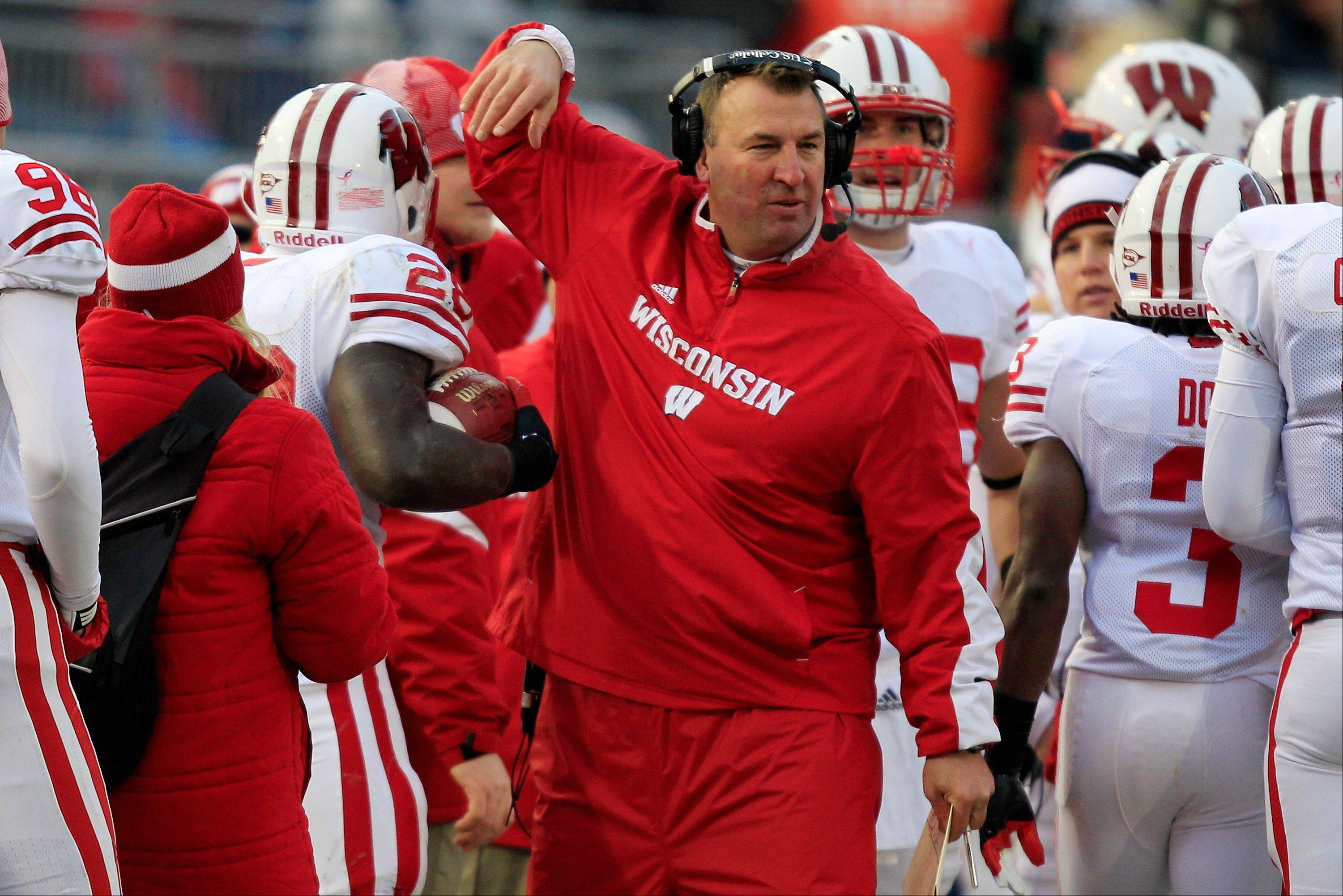 Wisconsin head coach Bret Bielema, center, celebrates with Wisconsin running back Montee Ball after a touchdown run during the first quarter of Saturday�s at Penn State. Wisconsin lost in overtime.