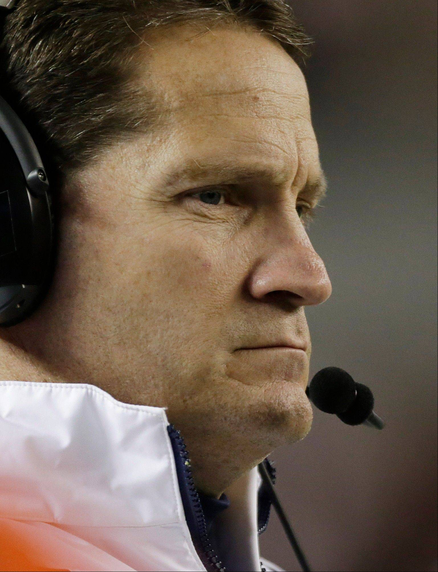 Auburn coach Gene Chizik watches the end of a 49-0 loss to Alabama on Saturday. Chizik was fired Sunday.