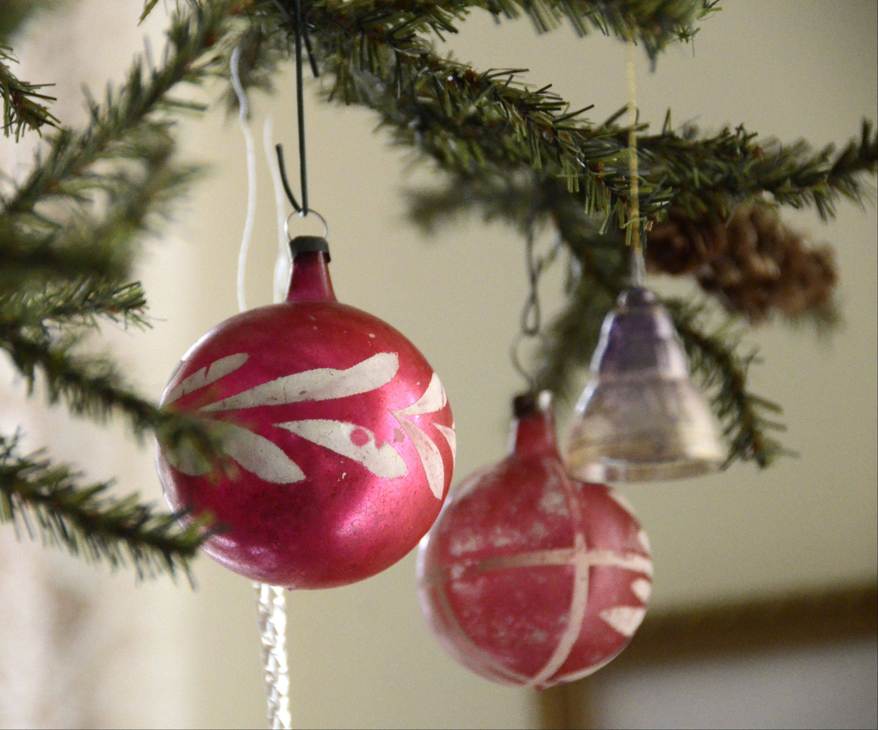 Antique ornaments adorn the dining room tree.
