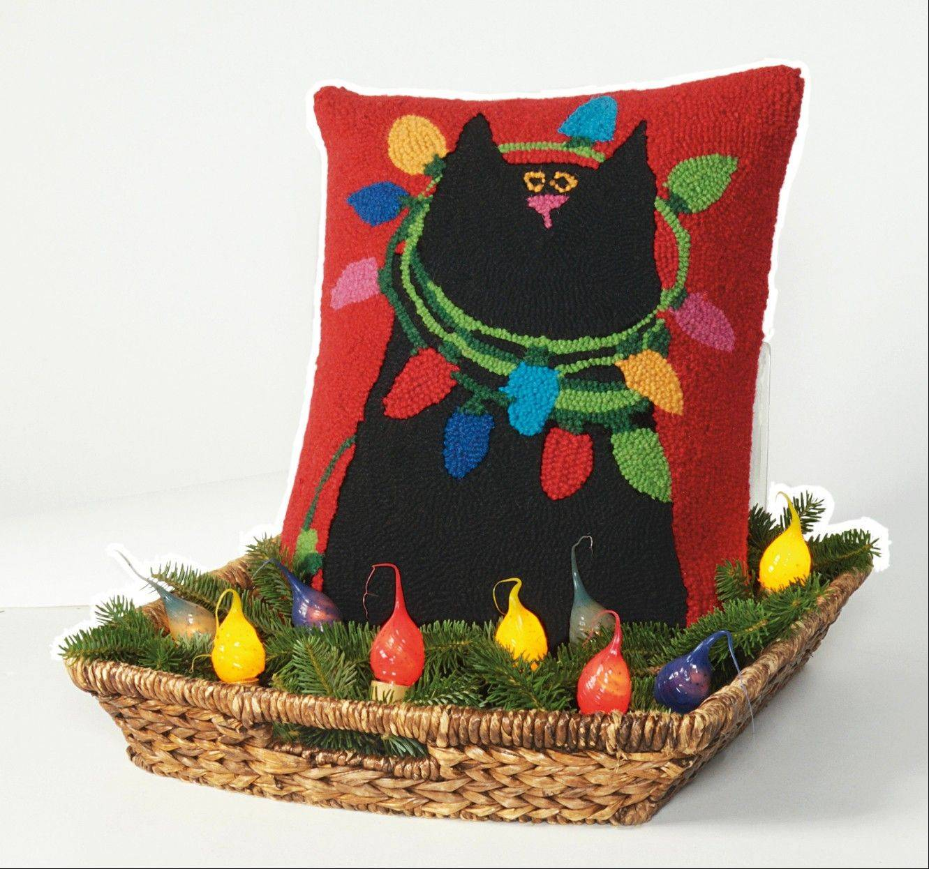 A colorful hooked pillow nestled in a basket of greens makes an easy and unique setting. Place it against a wall or solid surface so the pillow can stand up.