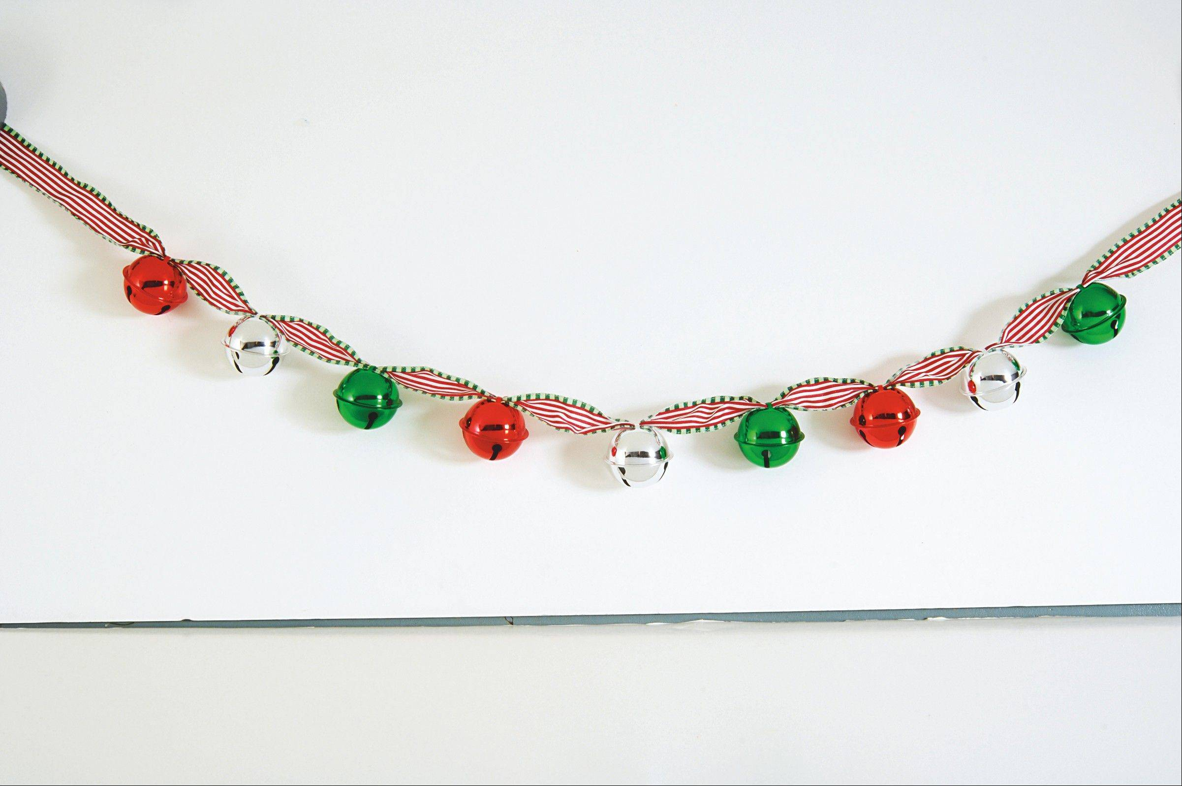 Want another quick trick to try? String shiny red, green and silver jingle bells on a seasonally striped ribbon to create a garland that's music to your ears.