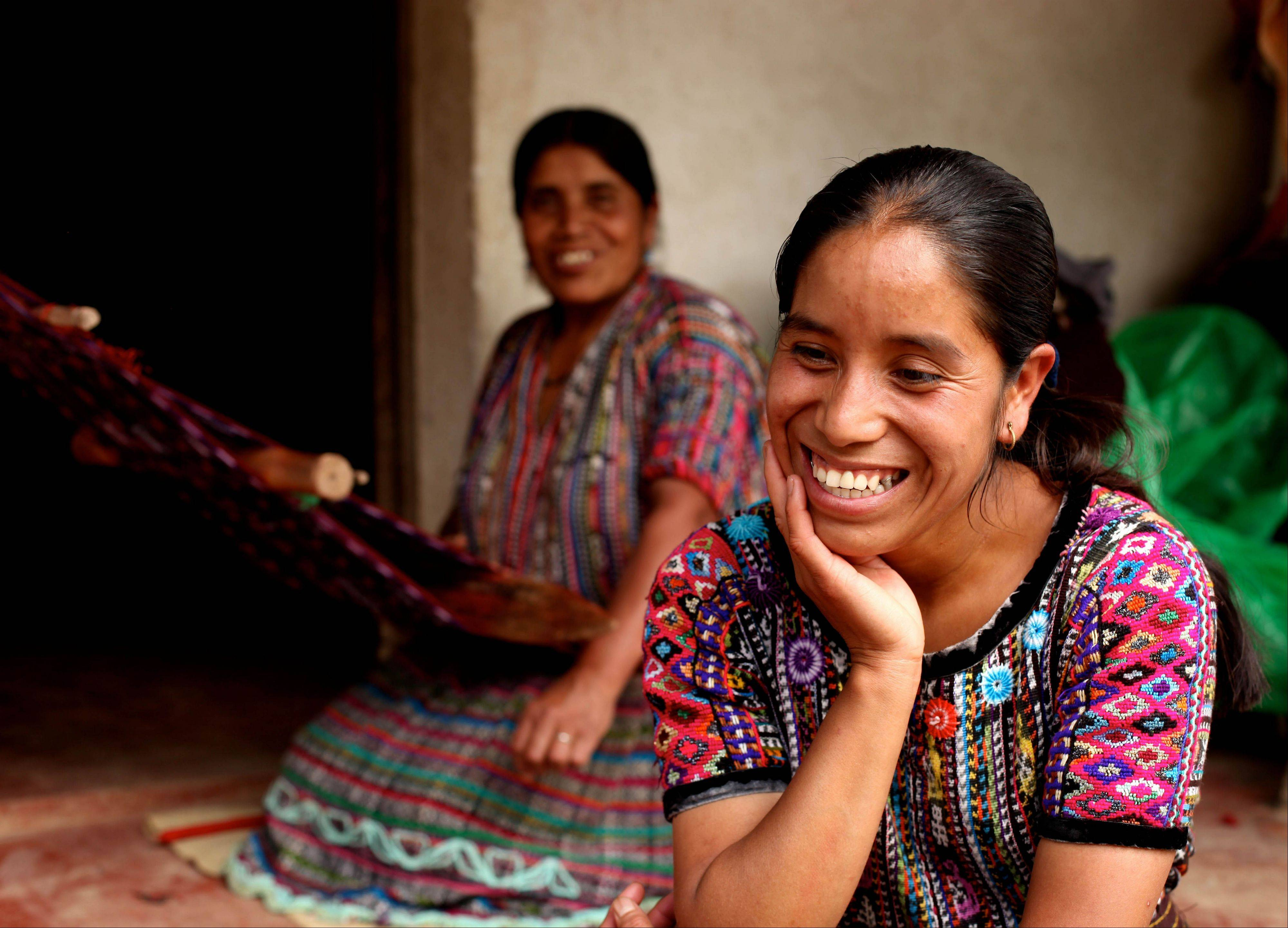 Rosa Coj Bocel, right, received a microloan to start a weaving business, with her mother in Pena Blanca, Guatemala.