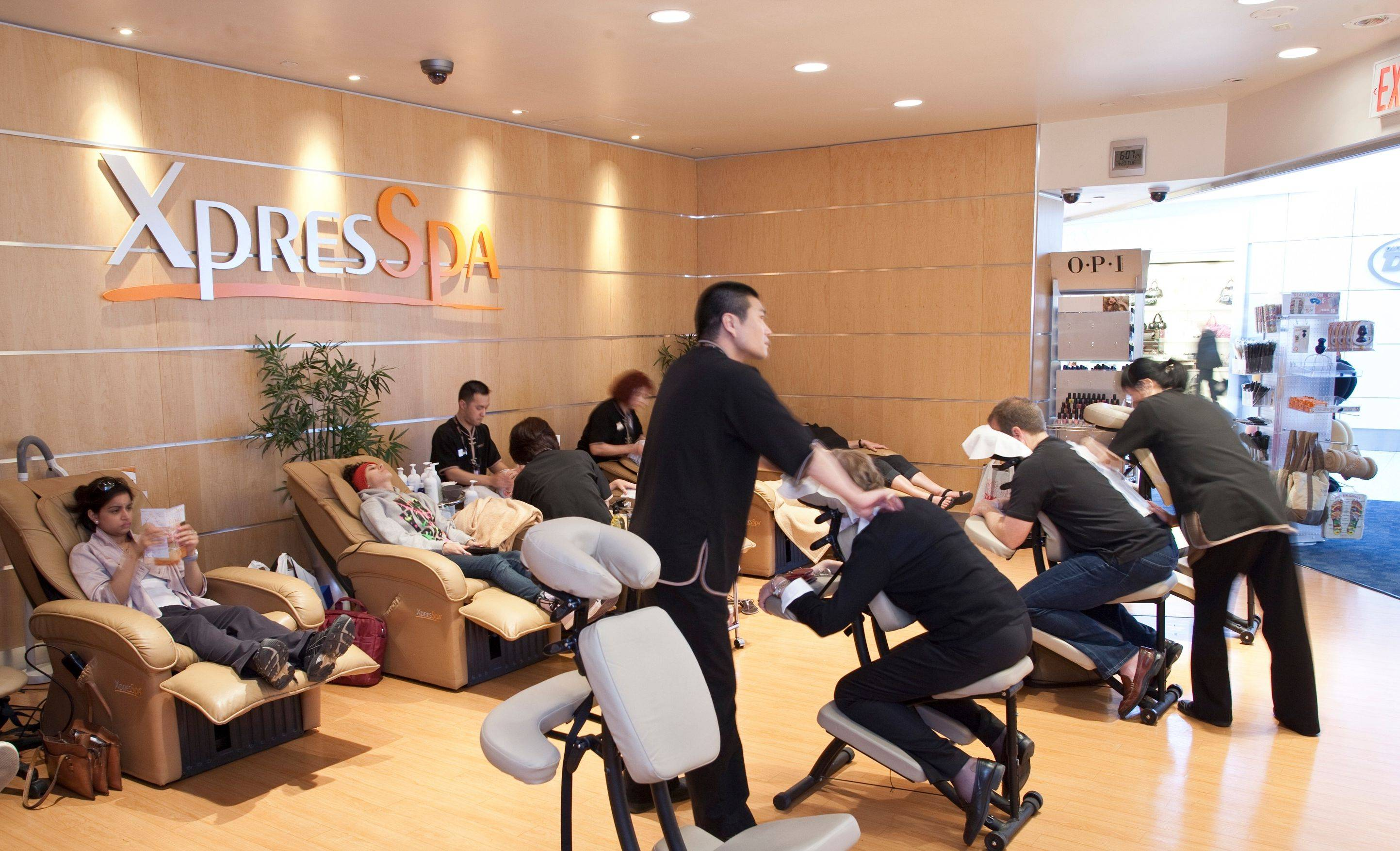 Customers receive massages and other treatments at the XpresSpa's spa at John F. Kennedy International Airport in New York.