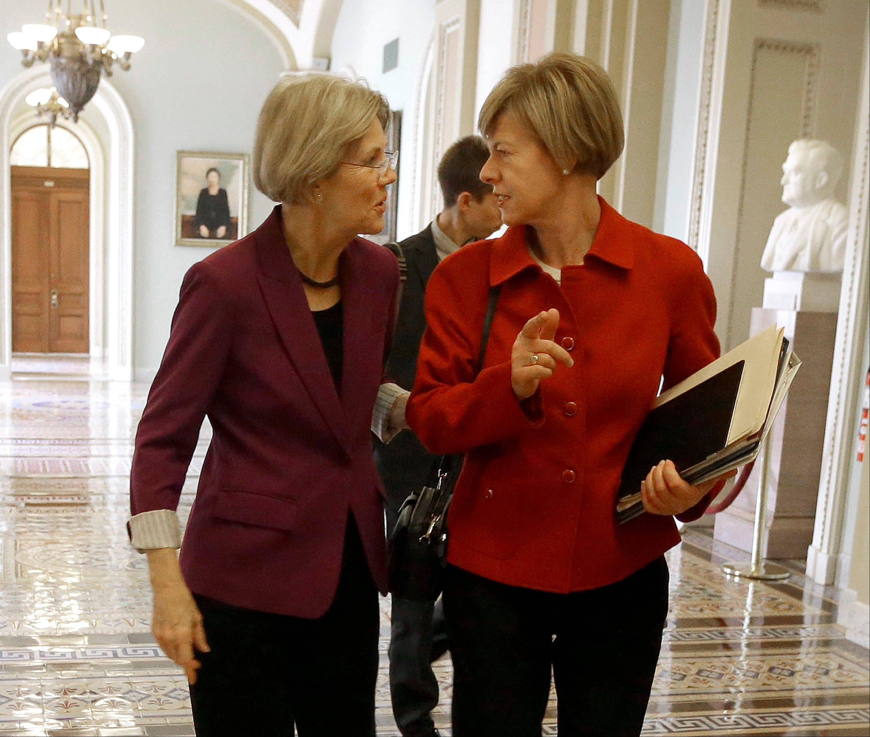 Sen.-elect Elizabeth Warren, a liberal Democrat from Massachusetts, left, and Sen.-elect Tammy Baldwin, a Wisconsin Democrat currently serving in the House, walk together on Capitol Hill in Washington earlier this month.