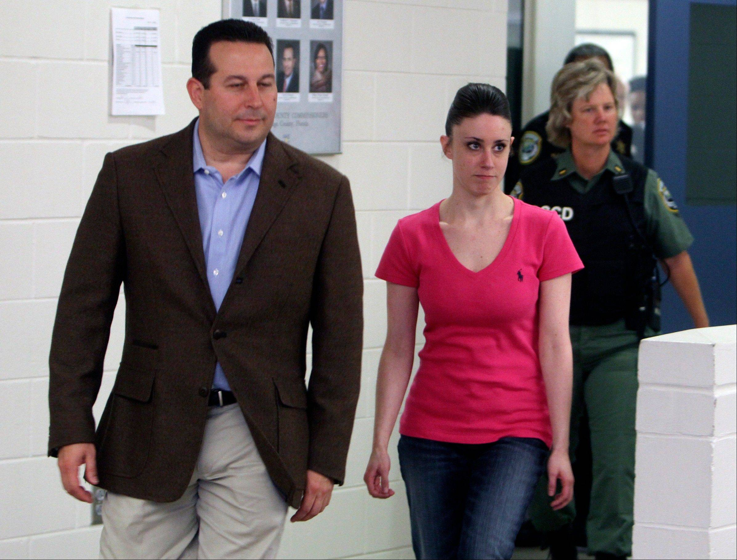 Casey Anthony, front right, walks out of the Orange County Jail with her attorney Jose Baez, left, during her release in Orlando, Fla., after being acquitted of murder in the death of her daughter Caylee on July 17, 2011.