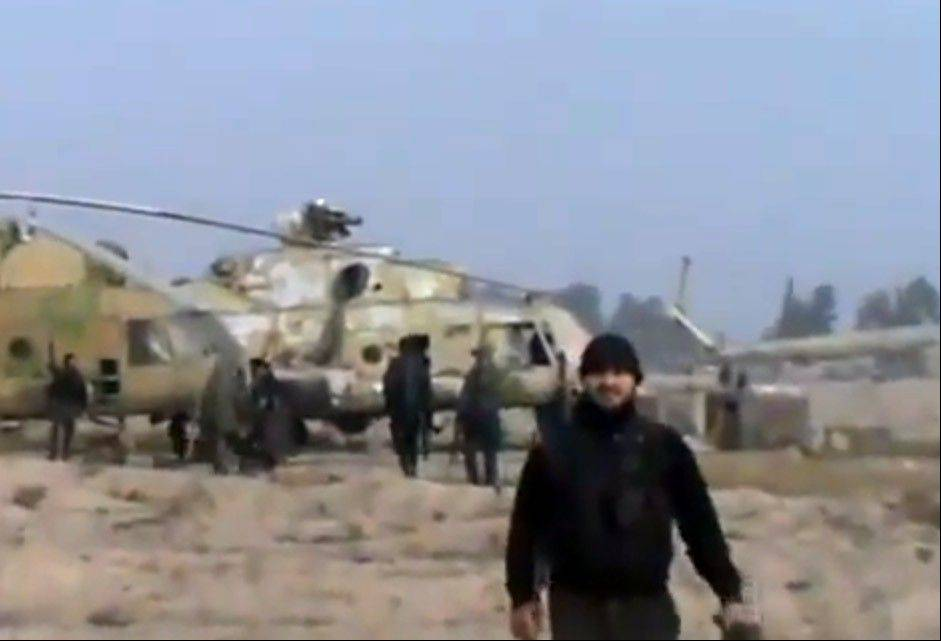 In this authenticated image taken from video obtained from the Ugarit News, Syrian rebels capture a helicopter air base near the capital Damascus after fierce fighting on Sunday.