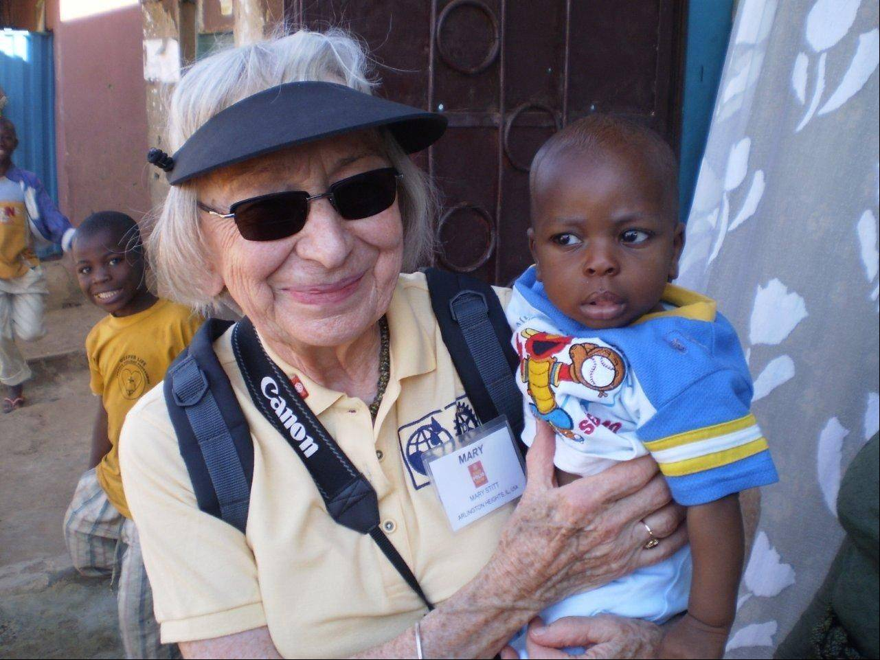 Mary Stitt holds a baby during her travels abroad to vaccinate children against polio.