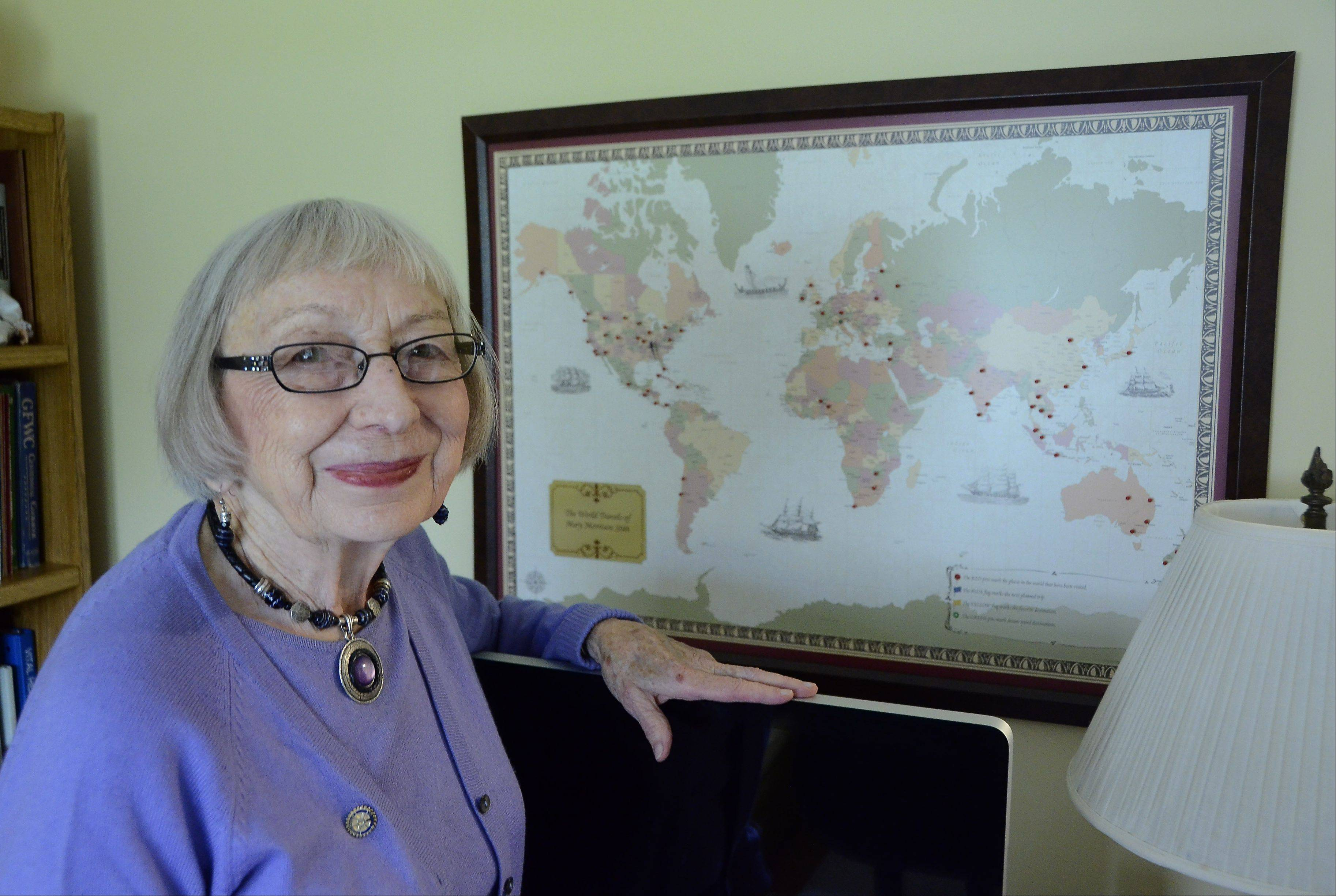 Mary Stitt, 87, of Arlington Heights is planning her fourth trip to Nigeria, where she helps administer polio vaccines and deliver wheelchairs. Pins on the map show her nearly 50 humanitarian trips since retirement. See story on Page 6.