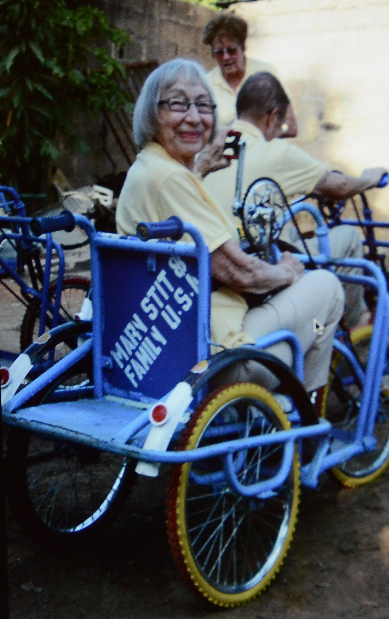 Stitt delivers a bicycle wheelchair to a polio survivor in Nigeria.