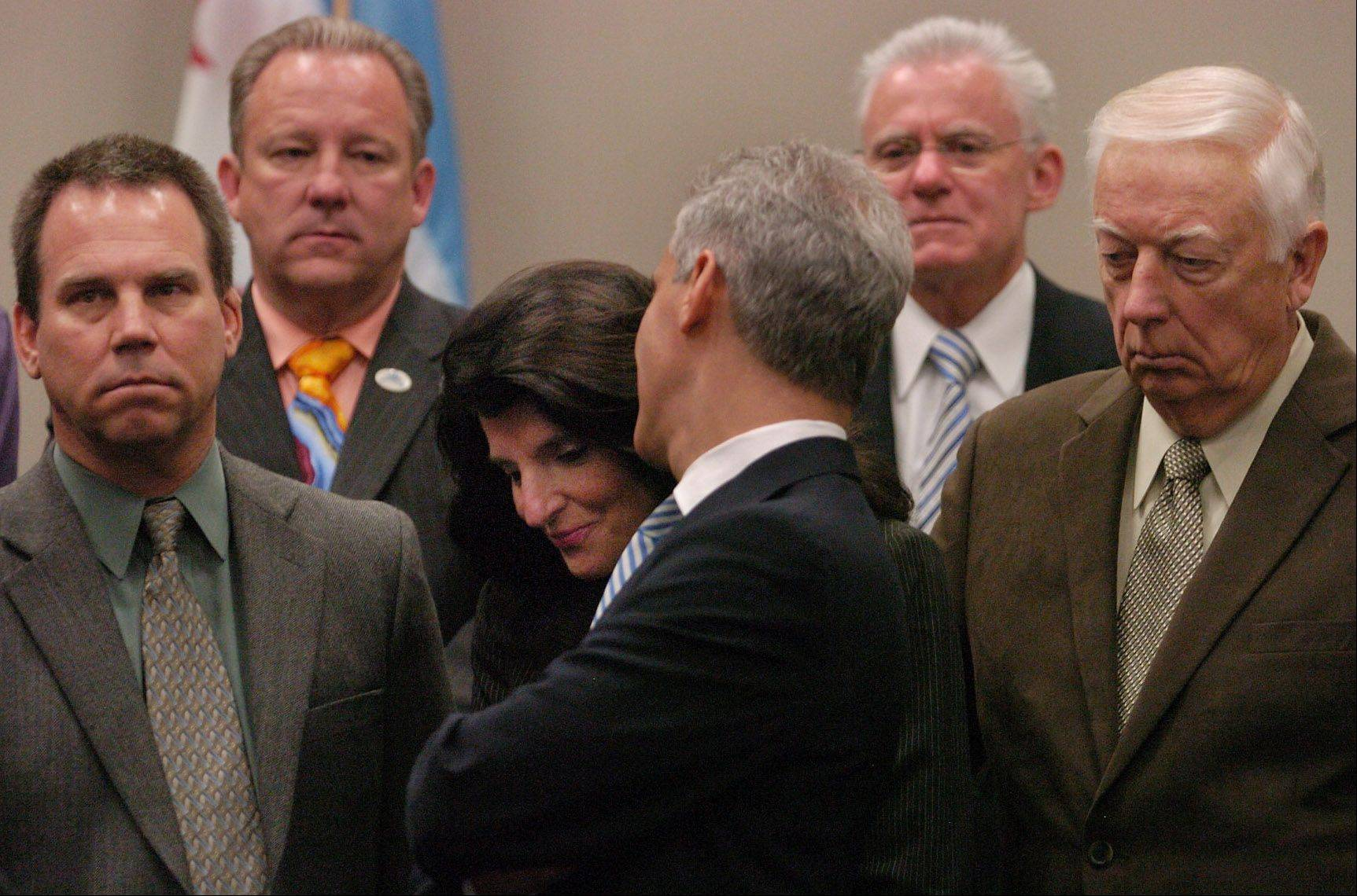 Bob Chwedyk/Daily Herald May 2012Suburban mayors joined forces with Chicago Mayor Rahm Emanuel in May to advocate for pension changes for municipal employees. Among them are Itasca Mayor Jeff Pruyn on the left, Barrington Mayor Karen Darch, center, and Addison Mayor Larry Hartwig on the right.