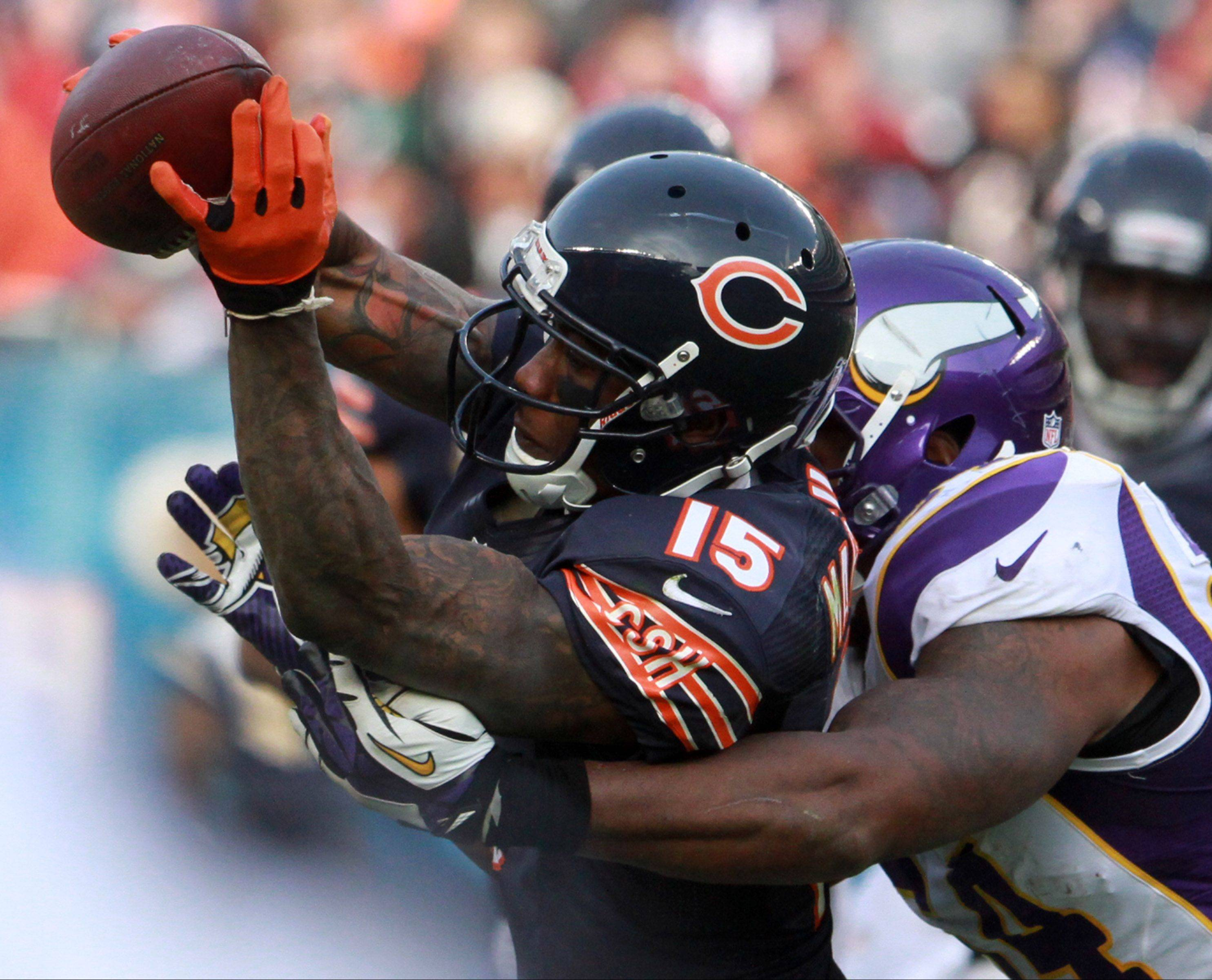 Brandon Marshall, who snared a dozen passes Sunday against the Vikings at Soldier Field, has 1,017 receiving yards this season.