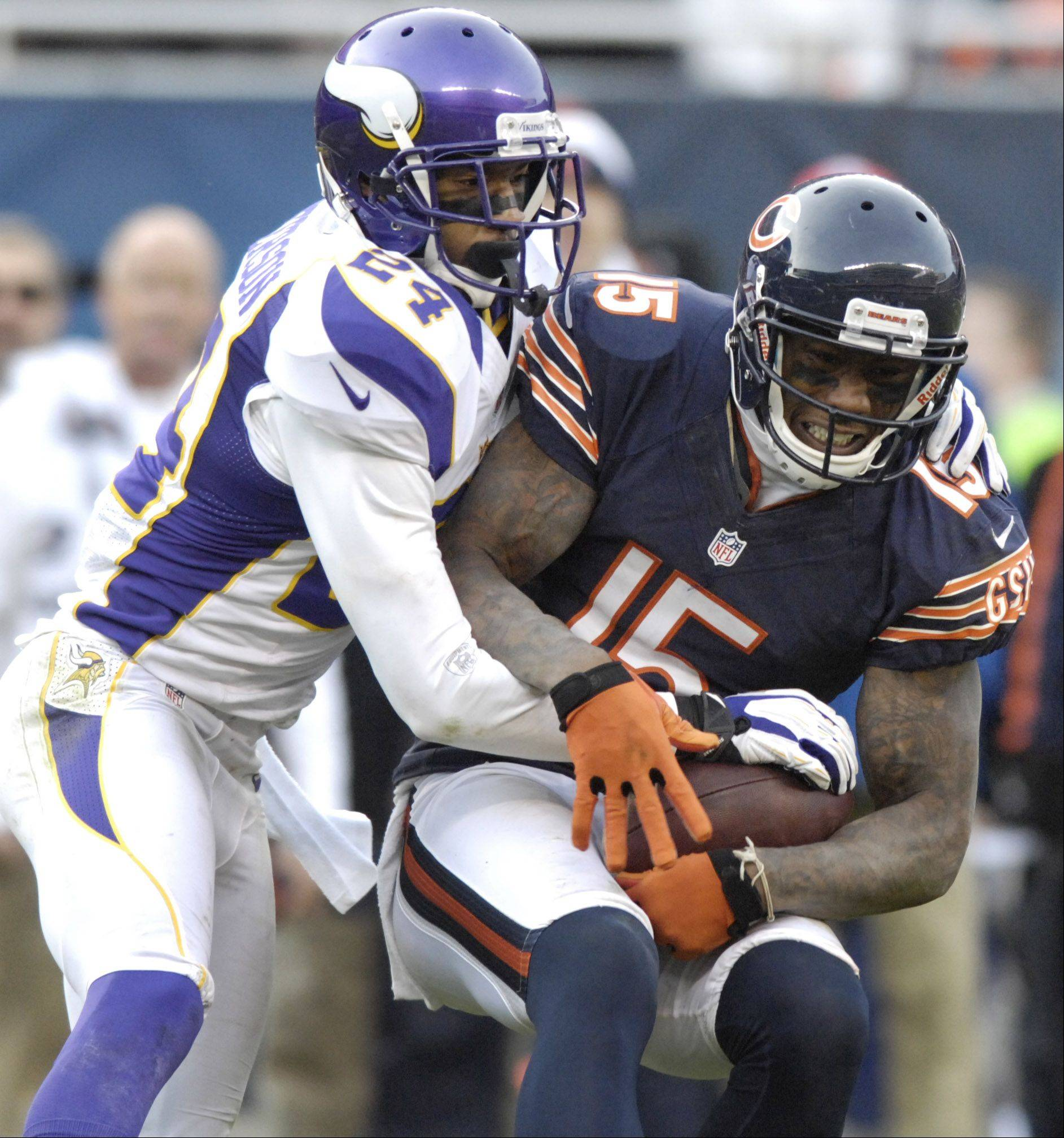 Chicago Bears wide receiver Brandon Marshall makes a catch against the defense of Minnesota Vikings cornerback A.J. Jefferson during the fourth quarter at Soldier Field Sunday.