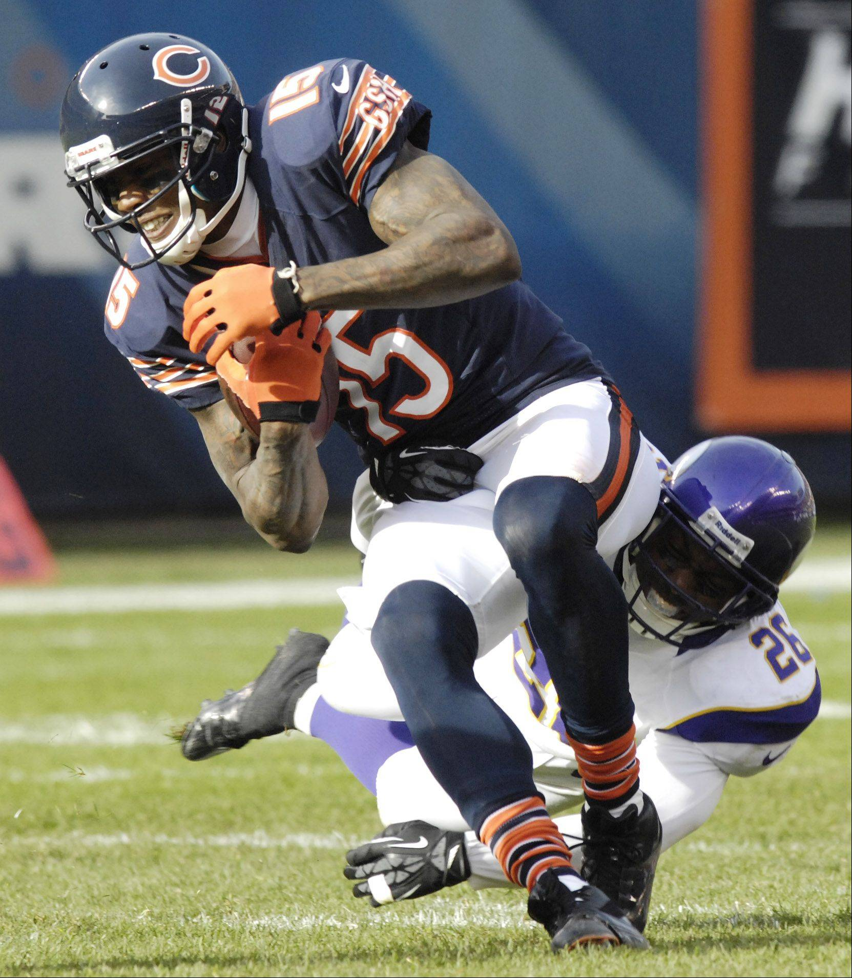 Chicago Bears wide receiver Brandon Marshall gets tackled by Minnesota Vikings cornerback Antoine Winfield at Soldier Field Sunday.
