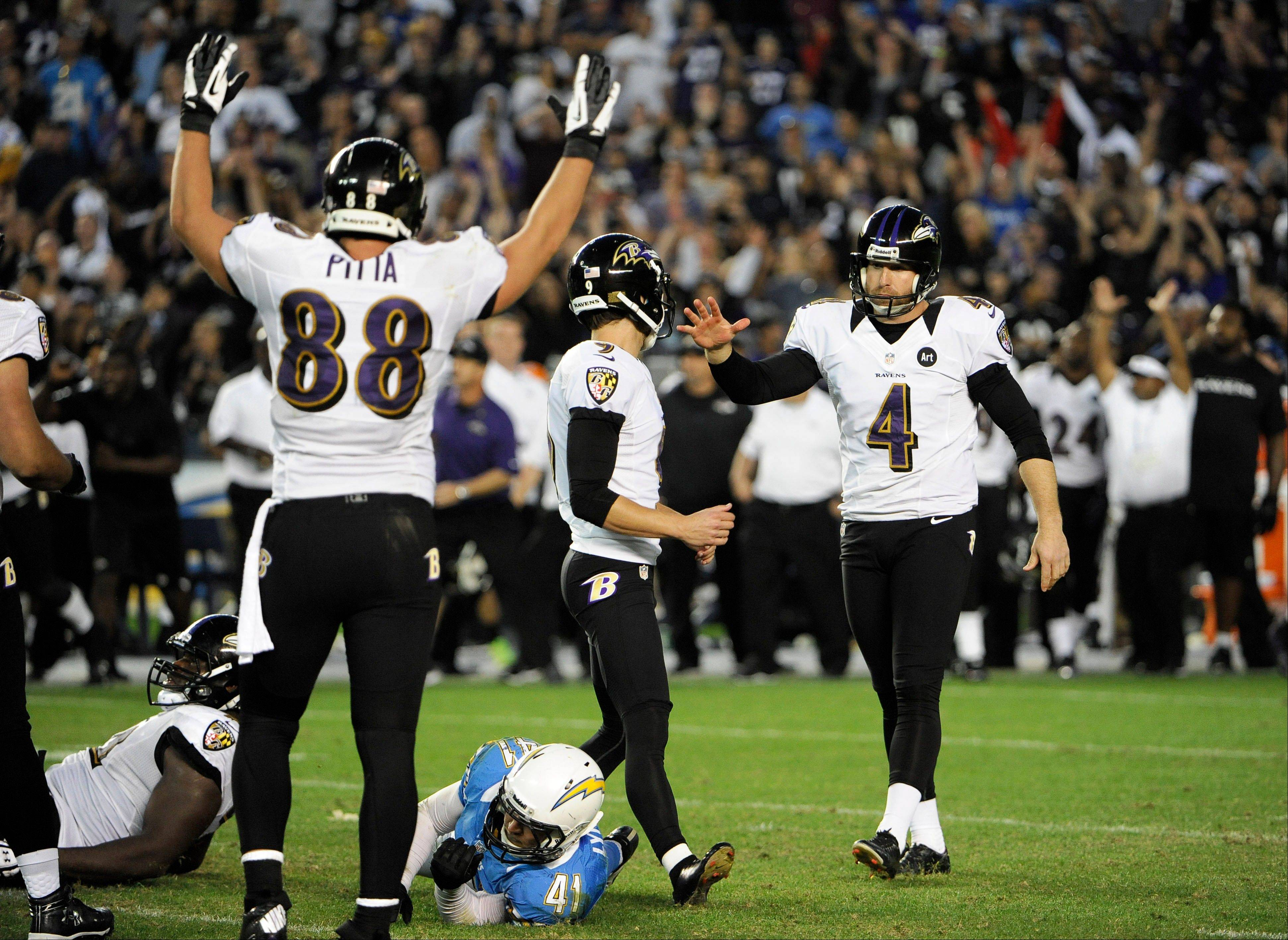 Baltimore Ravens kicker Justin Tucker (9) is congratulated by punter Sam Koch (4), as tight end Dennis Pitta (88) celebrates after Tucker kicked the game-winning field goal in overtime against the San Diego Chargers, Sunday in San Diego. The Ravens won 16-13.