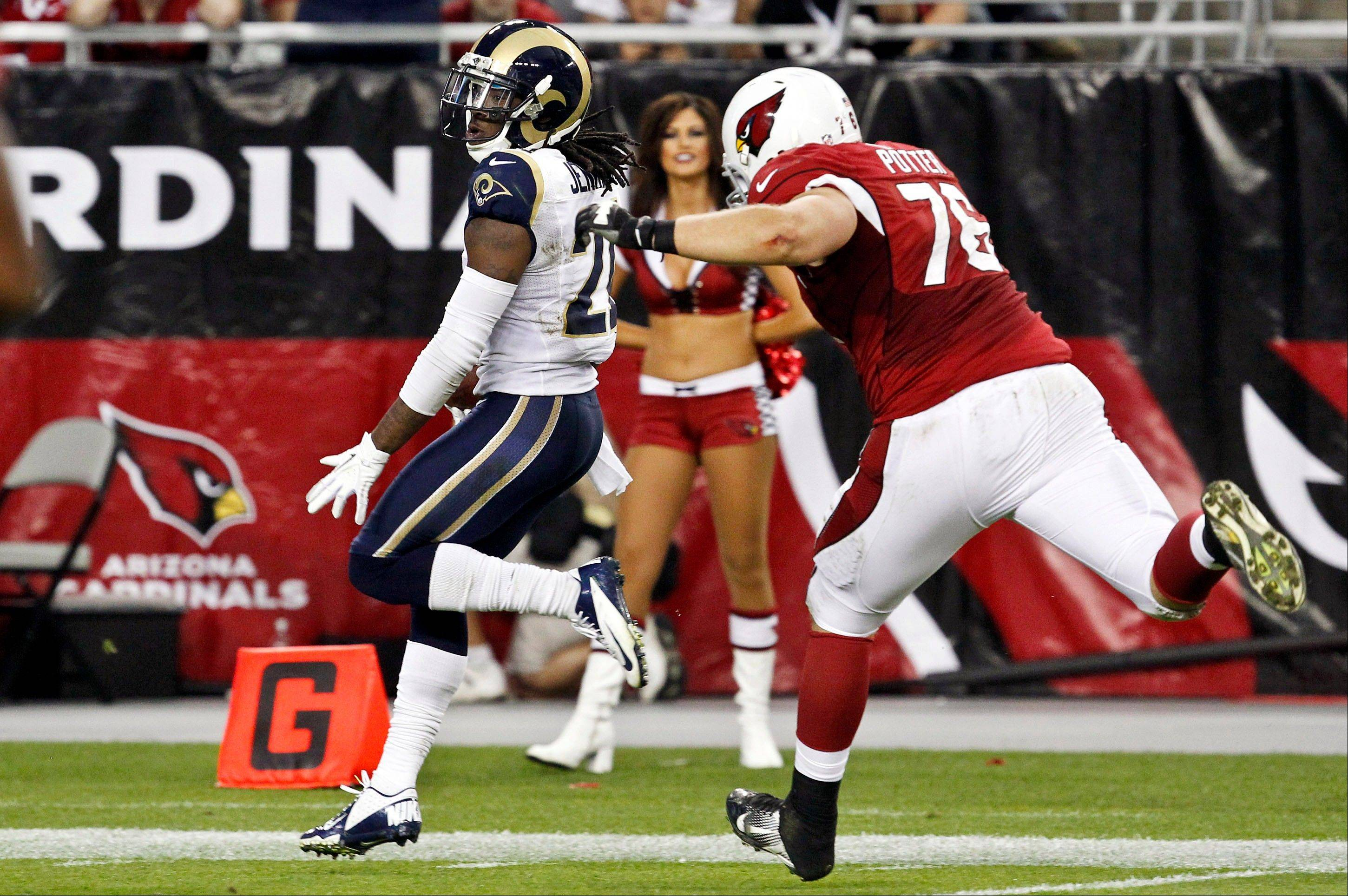 St. Louis Rams' Janoris Jenkins, left, returns an interception for a touchdown as Arizona Cardinals' Nate Potter gives chase during the second half Sunday, Nov. 25, 2012, in Glendale, Ariz. The Rams won 31-17.