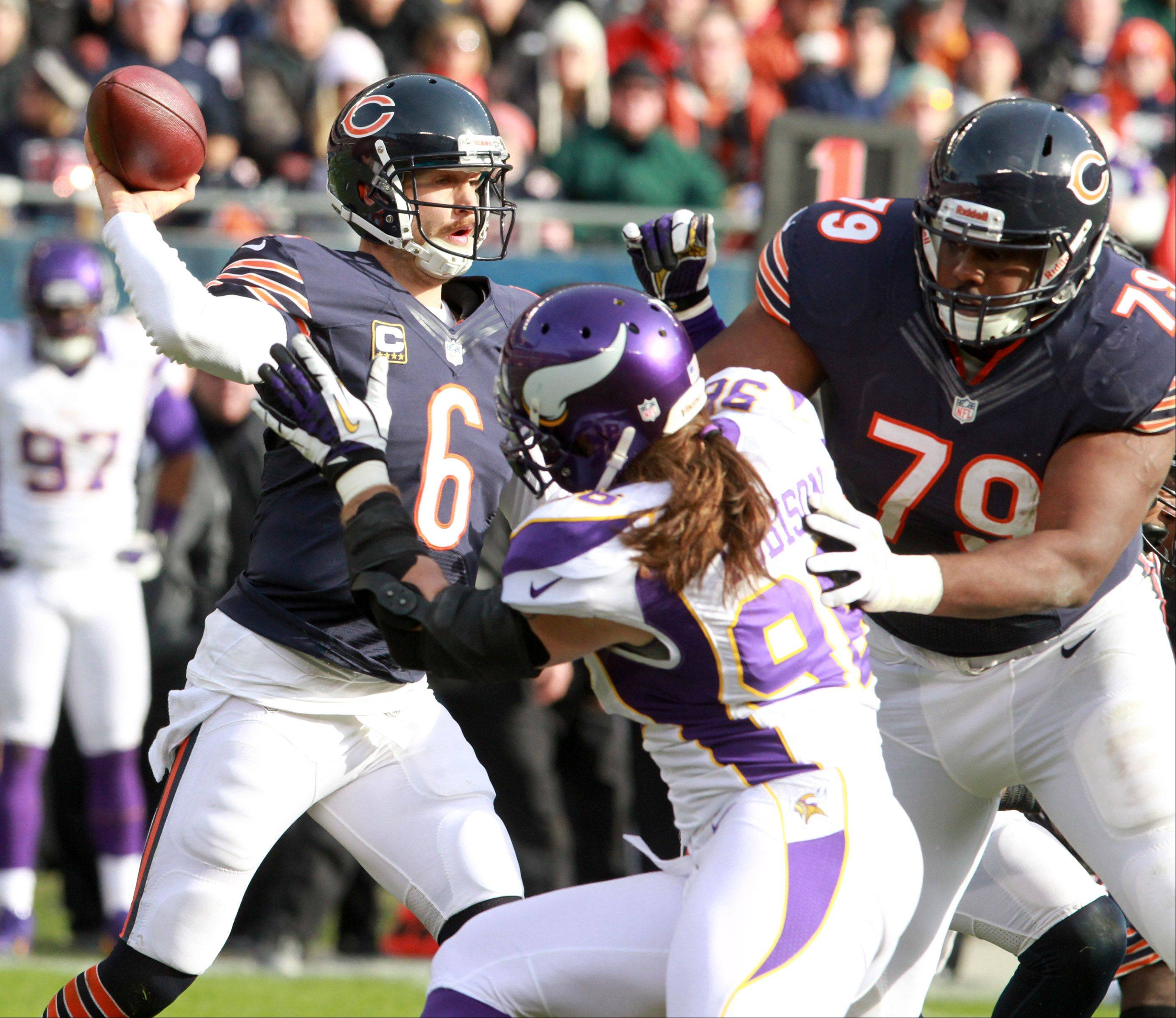 Chicago Bears quarterback Jay Cutler throws the ball as Bears tackle Jonathan Scott blocks Minnesota Vikings defensive end Brian Robison at Soldier Field Sunday.