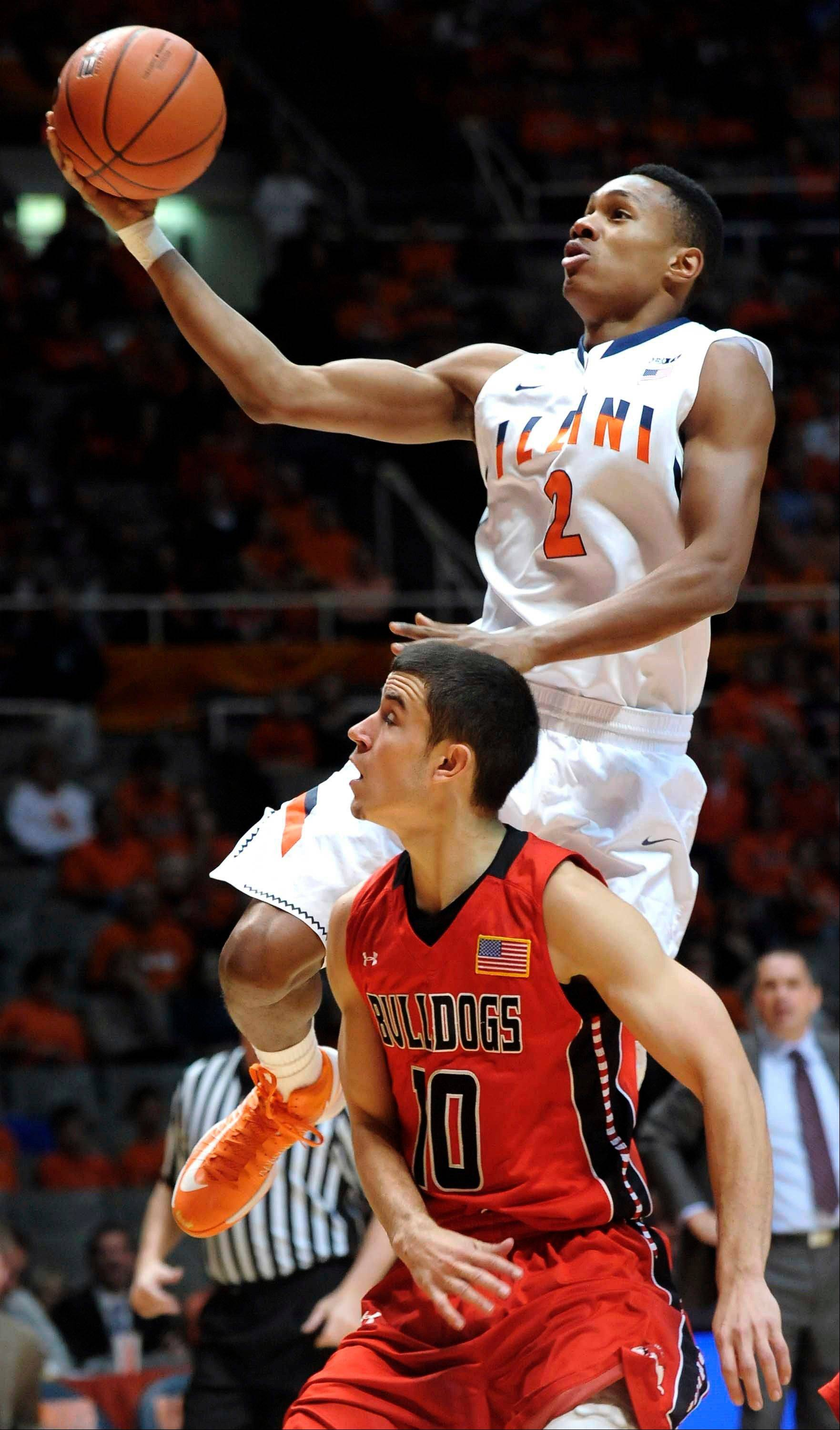 Illinois guard Joseph Bertrand shoots over Gardner-Webb guard Max Landis in the first half of their game Sunday at Assembly Hall in Champaign.