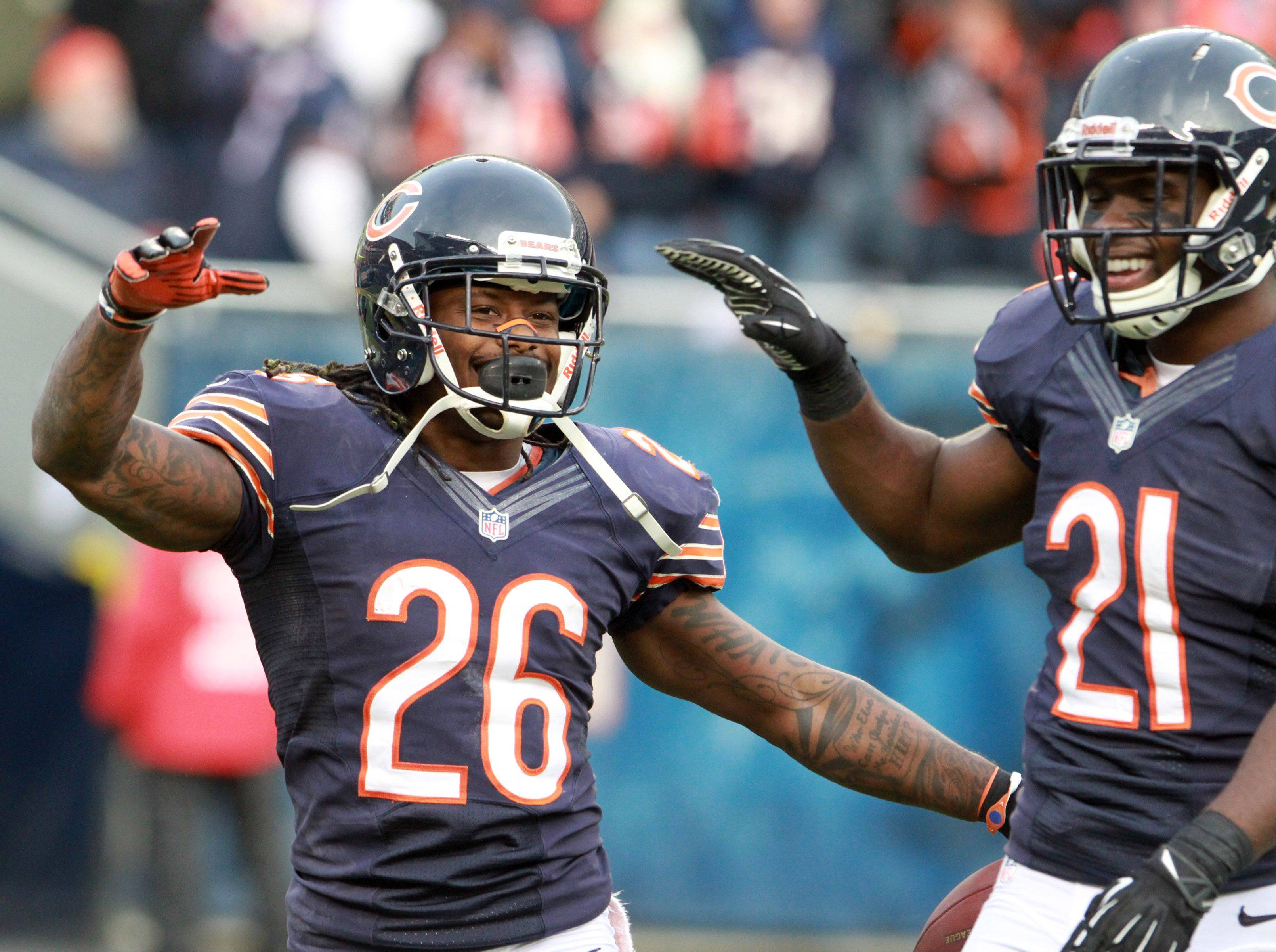 Chicago Bears cornerback Tim Jennings, left, celebrates an intercepting with Major Wright at Soldier Field Sunday.