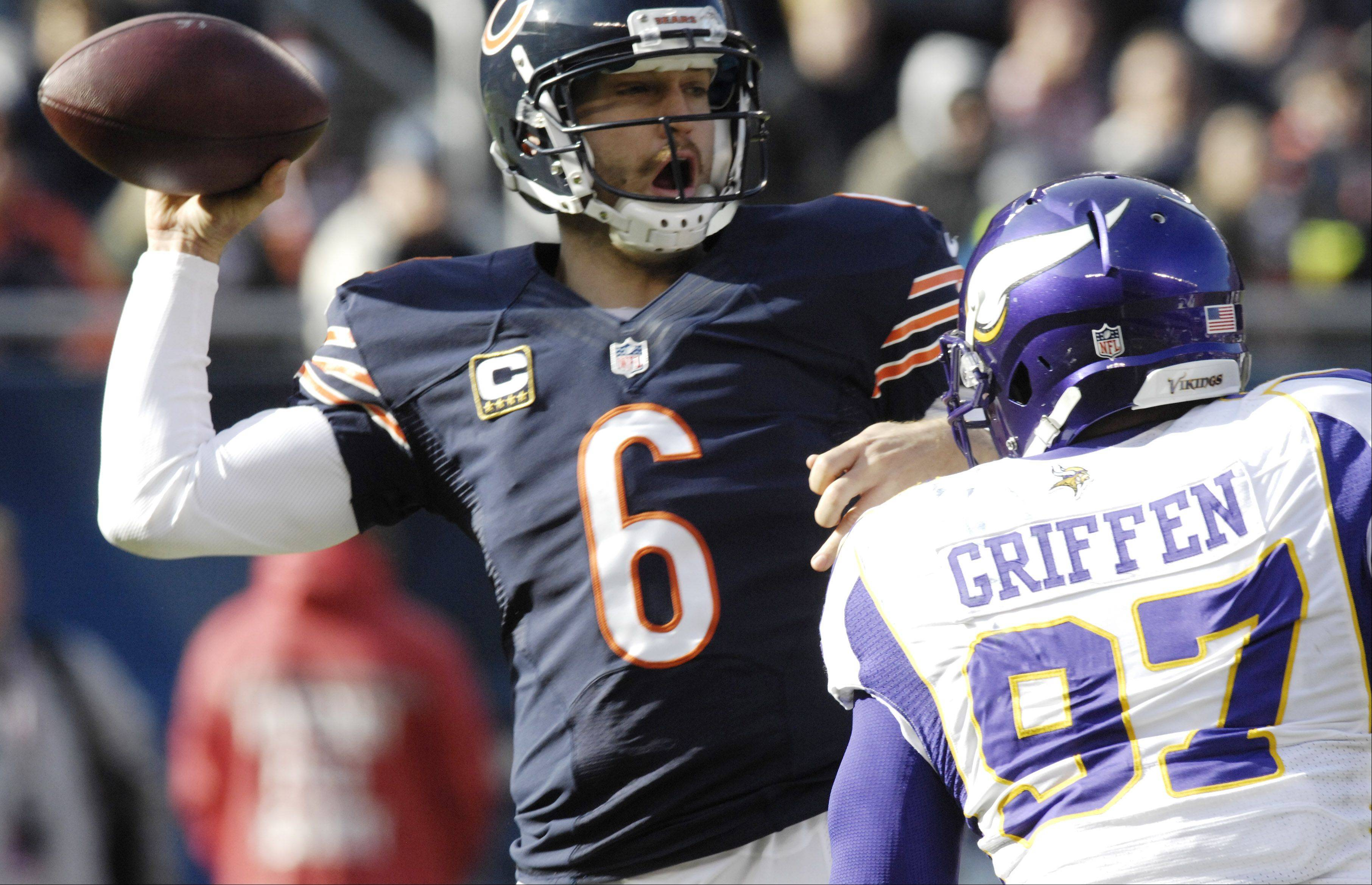 Chicago Bears quarterback Jay Cutler throws a pass as Minnesota Vikings defensive end Everson Griffen closes in at Soldier Field Sunday.