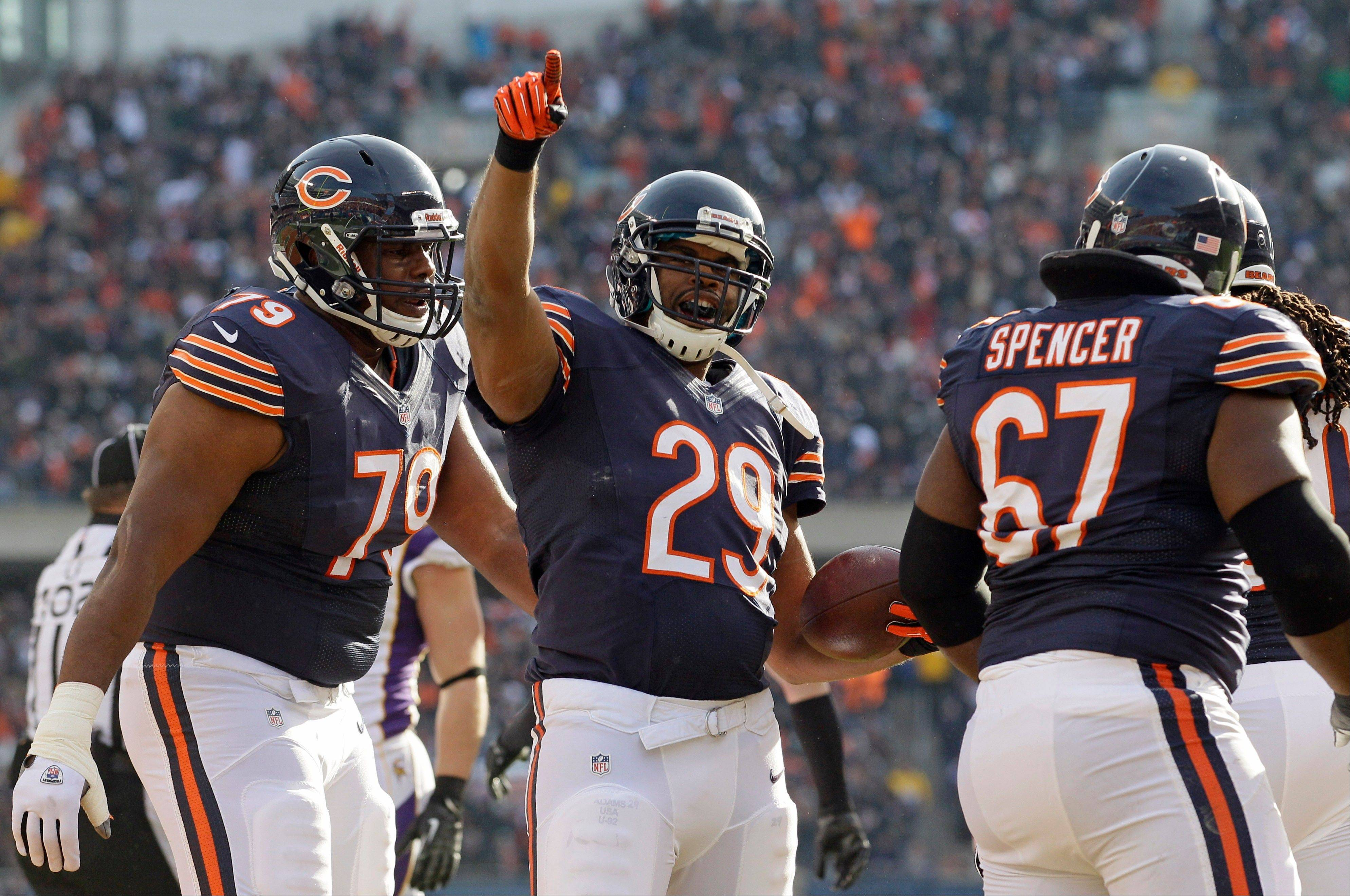 Chicago Bears running back Michael Bush (29) celebrates his touchdown run against the Minnesota Vikings in the first half of an NFL football game in Chicago, Sunday.