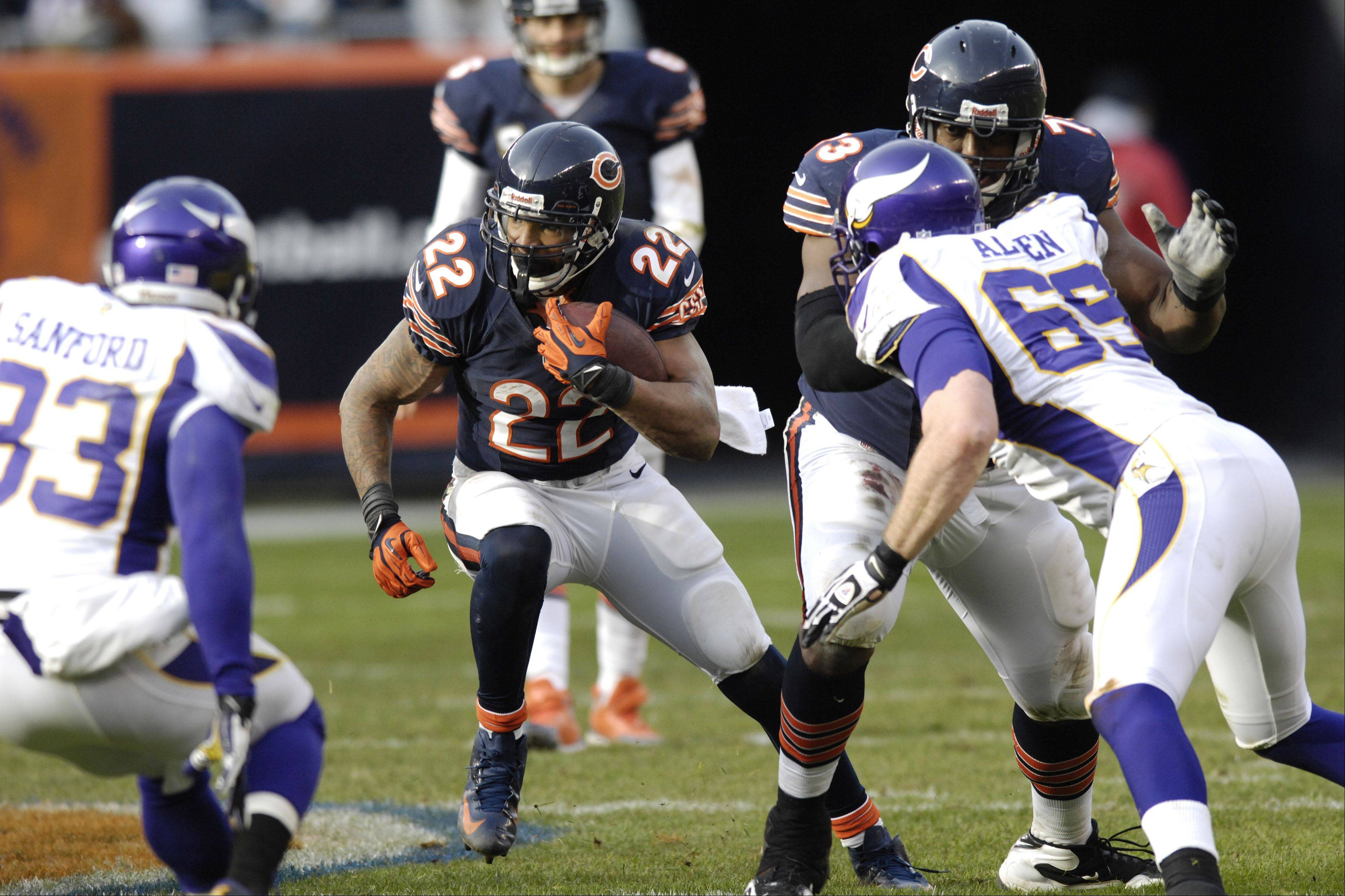 Chicago Bears running back Matt Forte carries the ball against Minnesota Vikings on a play that was initially ruled a fumble and a subsequent Vikings touchdown during the third quarter at Soldier Field Sunday. The play was called back on after review.