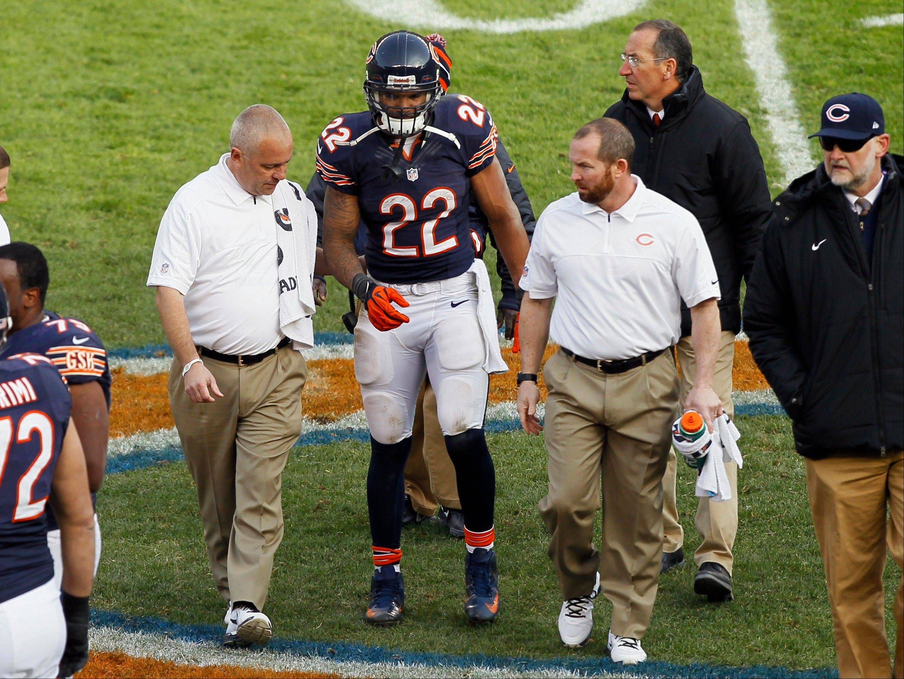 Chicago Bears running back Matt Forte (22) walks off the field with trainers after an injury in the second half of an NFL football game against the Minnesota Vikings in Chicago, Sunday.