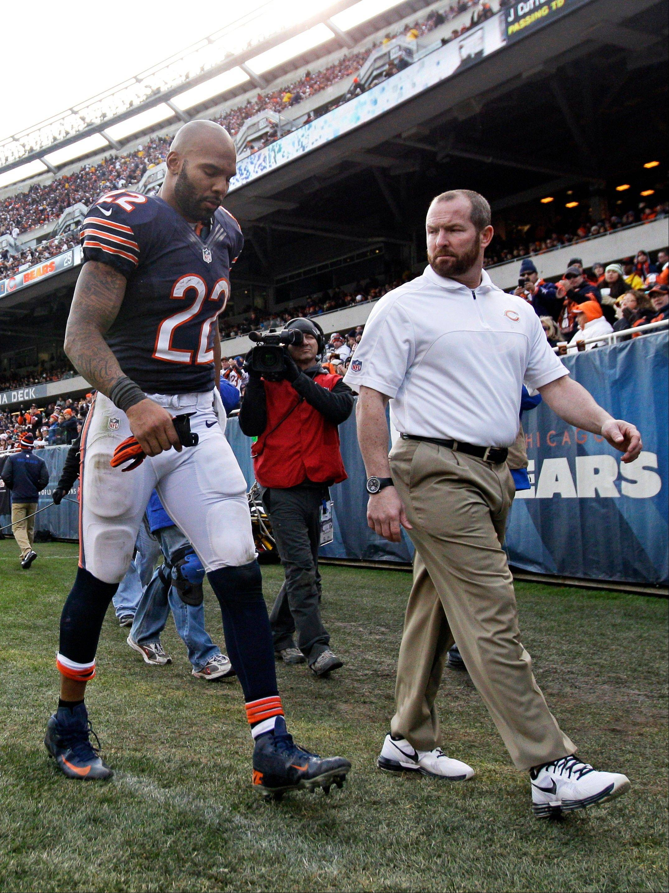 Chicago Bears running back Matt Forte (22) walks to the locker room with a trainer after getting injured in the second half of an NFL football game against the Minnesota Vikings in Chicago, Sunday.