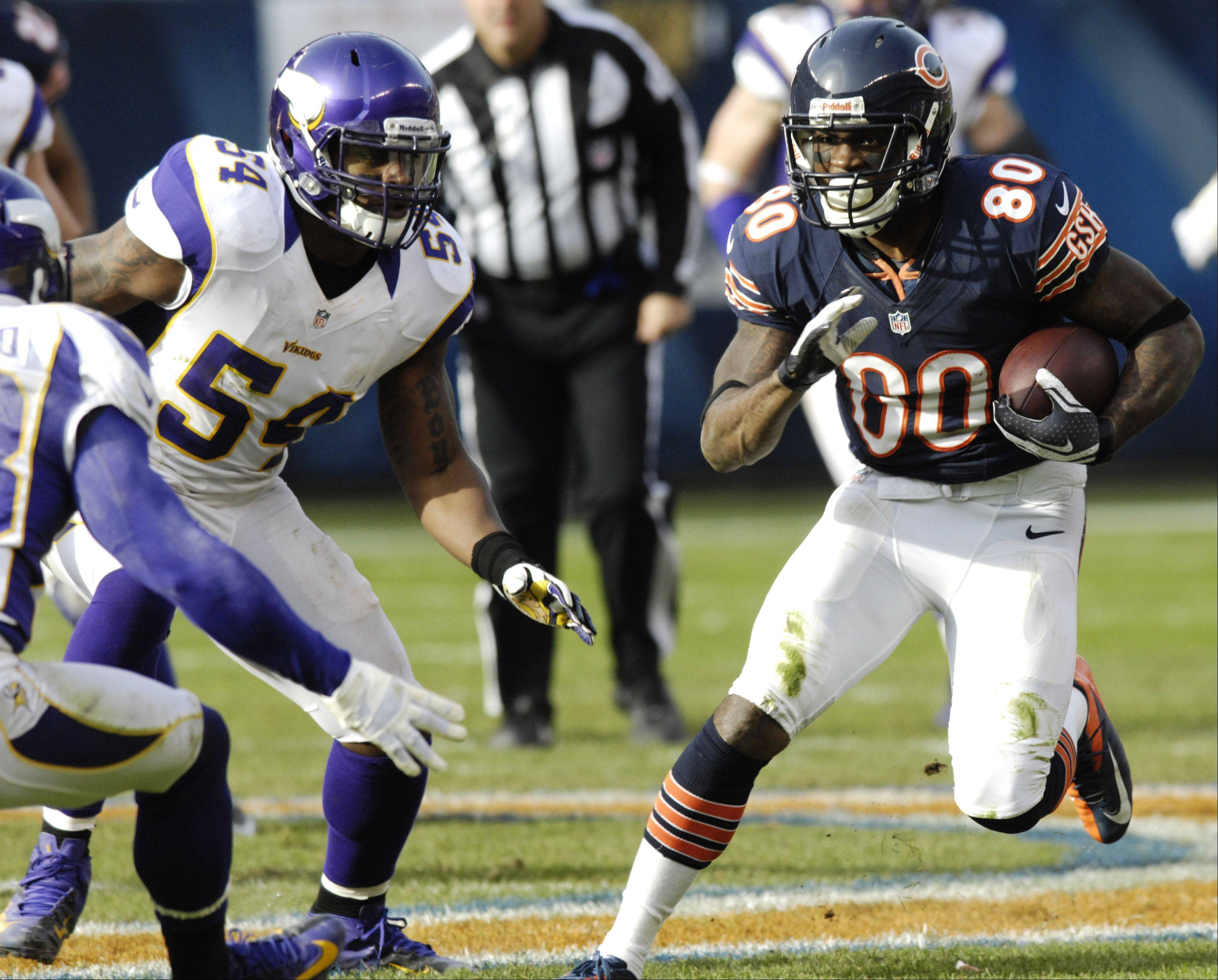 Chicago Bears wide receiver Earl Bennett carries the ball against the Minnesota Vikings at Soldier Field Sunday.