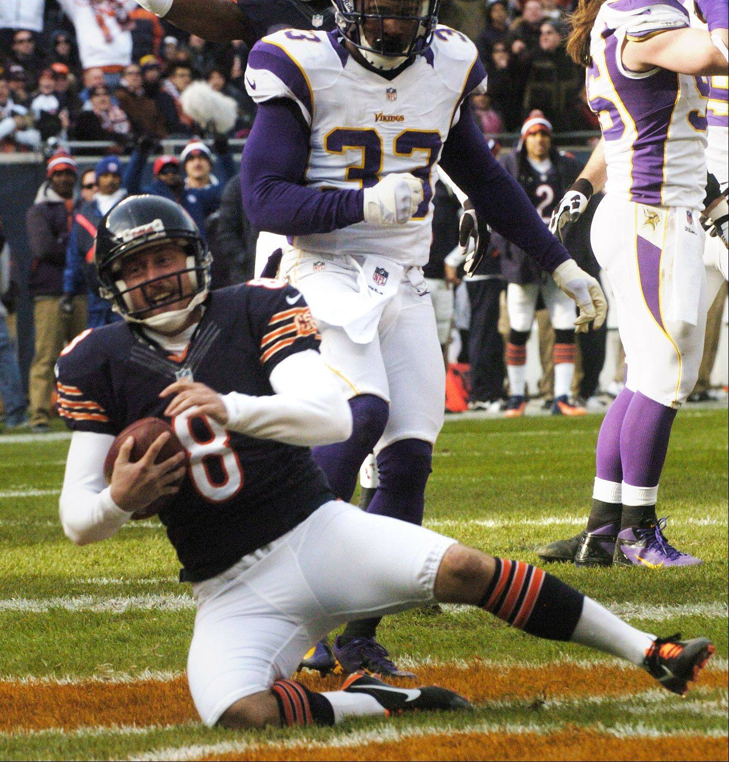 Chicago Bears holder Adam Podlesh scores on a two-point conversion against the Minnesota Vikings during the second at Soldier Field Sunday.