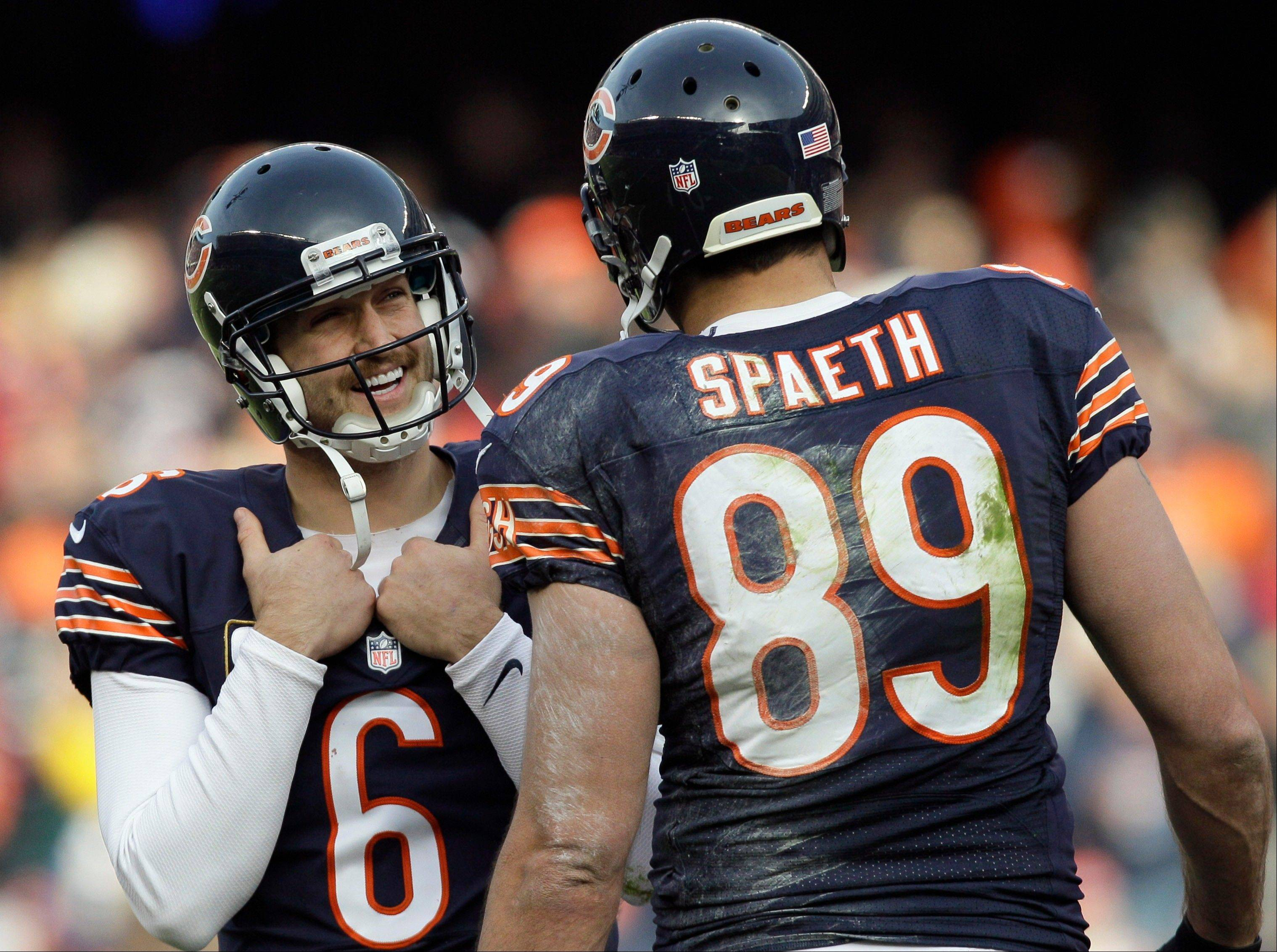 Chicago Bears quarterback Jay Cutler (6) smiles as he talks to Chicago Bears tight end Matt Spaeth (89) during a play review in the first half of an NFL football game against the Minnesota Vikings. After the review, officials ruled that Spaeth had made a touchdown catch.