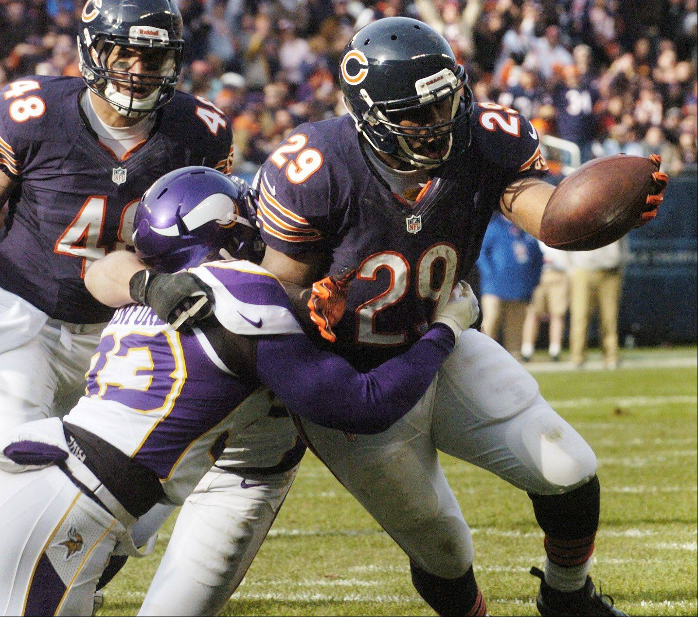 Chicago Bears running back Michael Bush carries the ball for a second-quarter touchdown as he gets past Minnesota Vikings strong safety Jamarca Sanford at Soldier Field Sunday.
