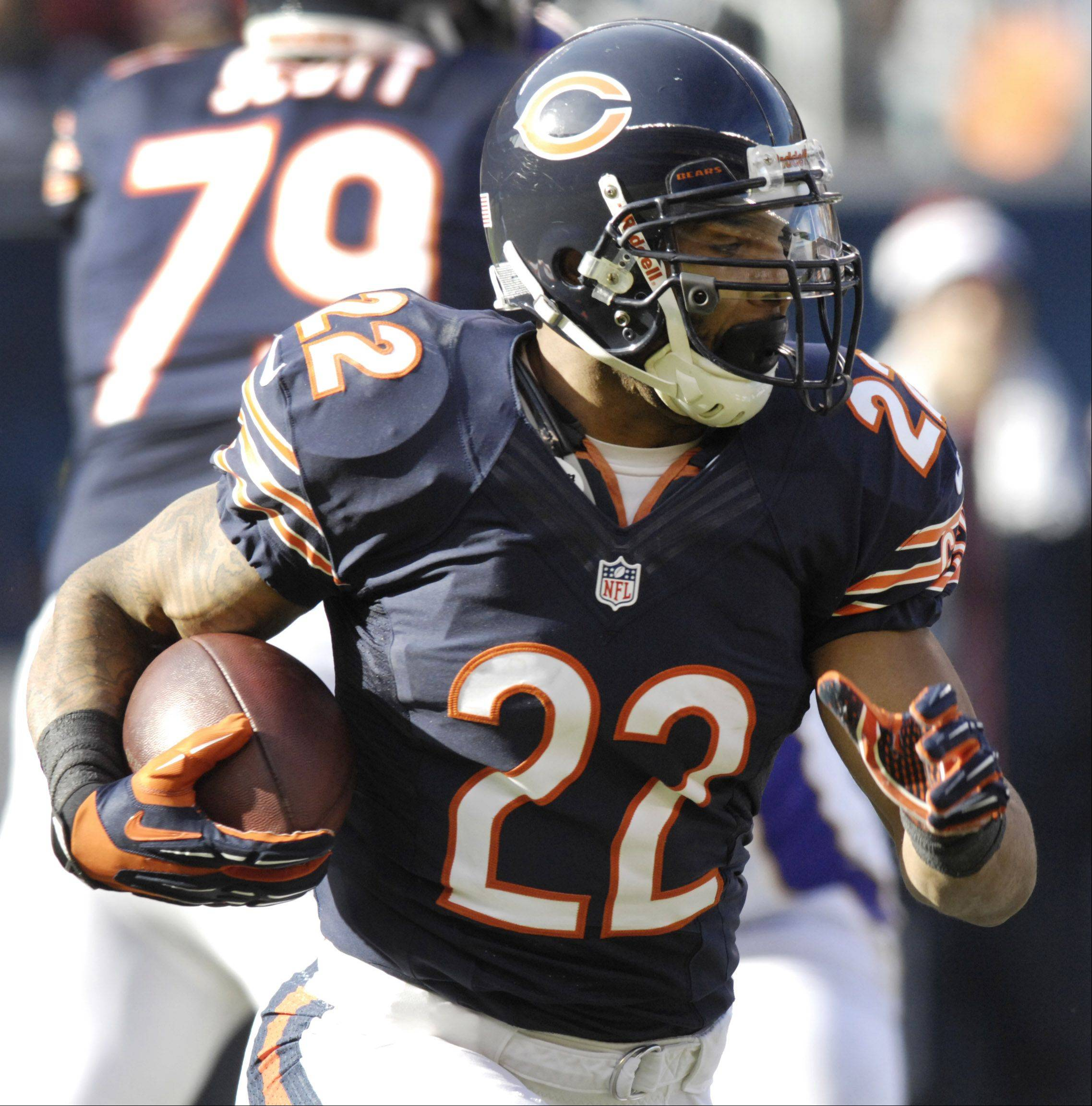 Matt Forte of the Chicago Bears carries the ball against the Minnesota Vikings at Soldier Field Sunday.