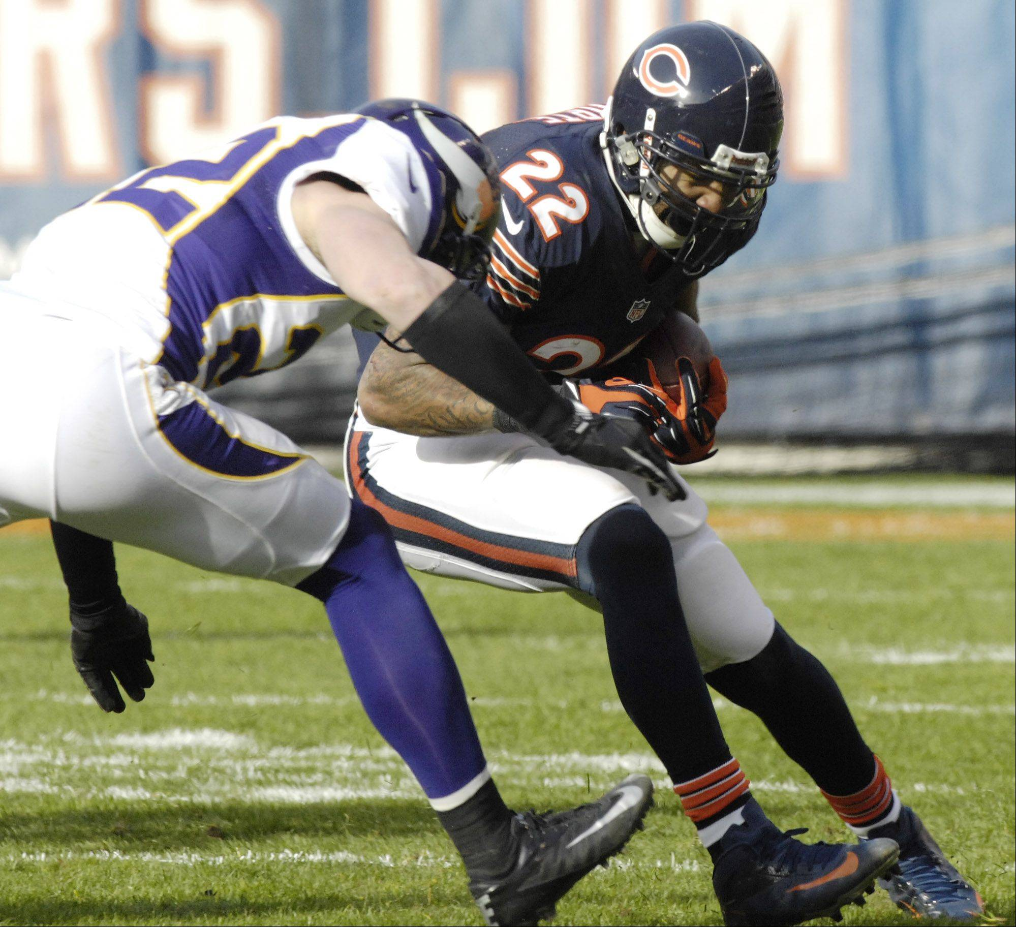 Chicago Bears running back Matt Forte gets tackled by Minnesota Vikings free safety Harrison Smith during the second quarter at Soldier Field Sunday.