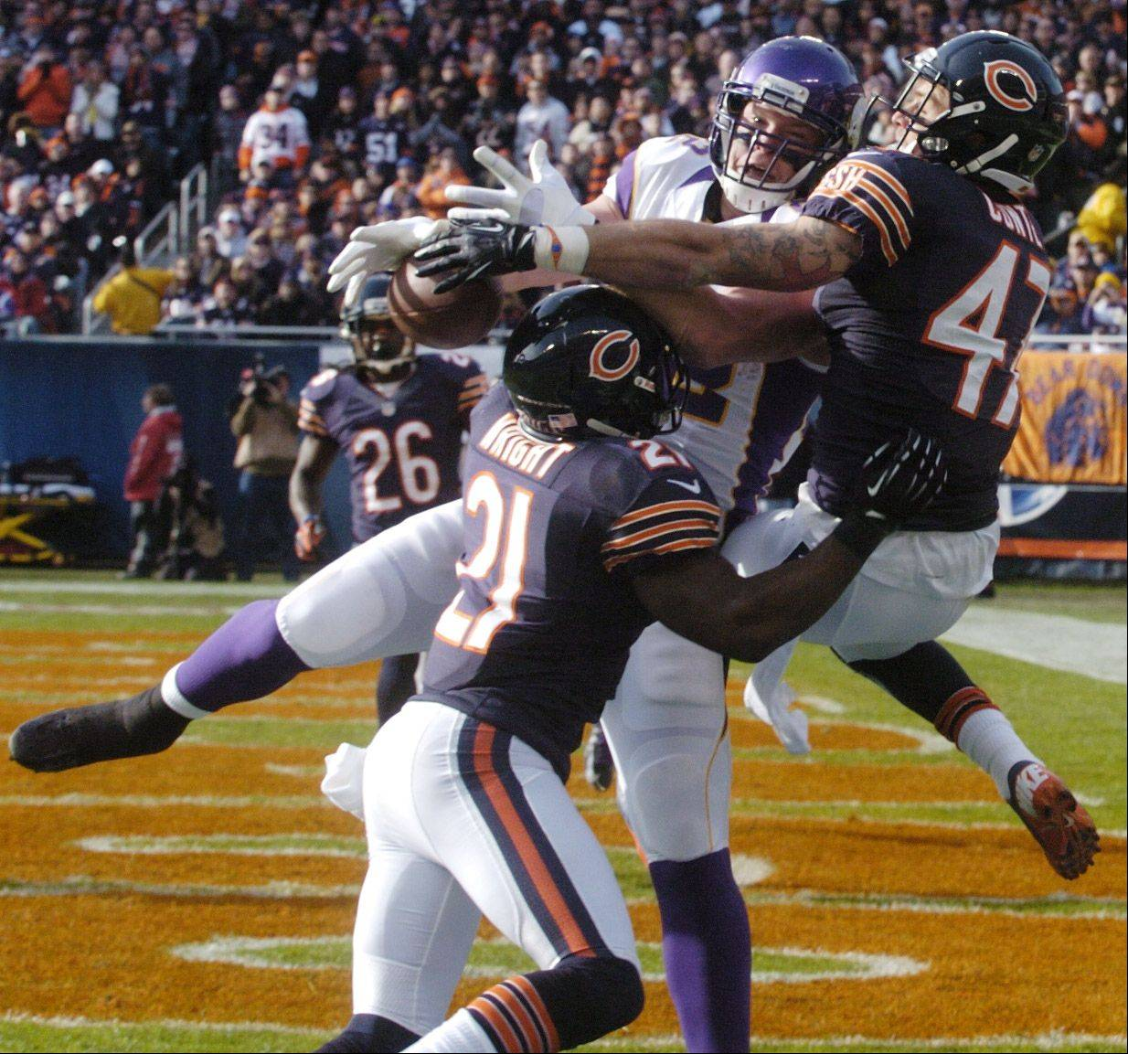 Chicago Bears strong safety Major Wright, left, and free safety Chris Conte force an incompletion by Minnesota Vikings tight end Kyle Rudolph in the end zone during the second quarter at Soldier Field Sunday.