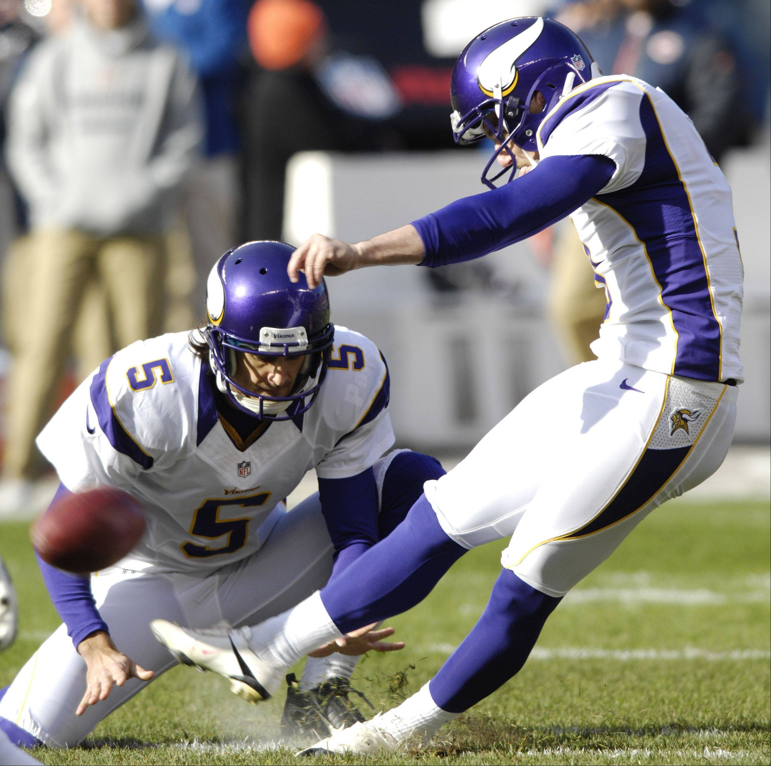 Minnesota Vikings kicker Blair Walsh kicks a field goal with Chris Kluwe holding during the first quarter against the Bears at Soldier Field Sunday.