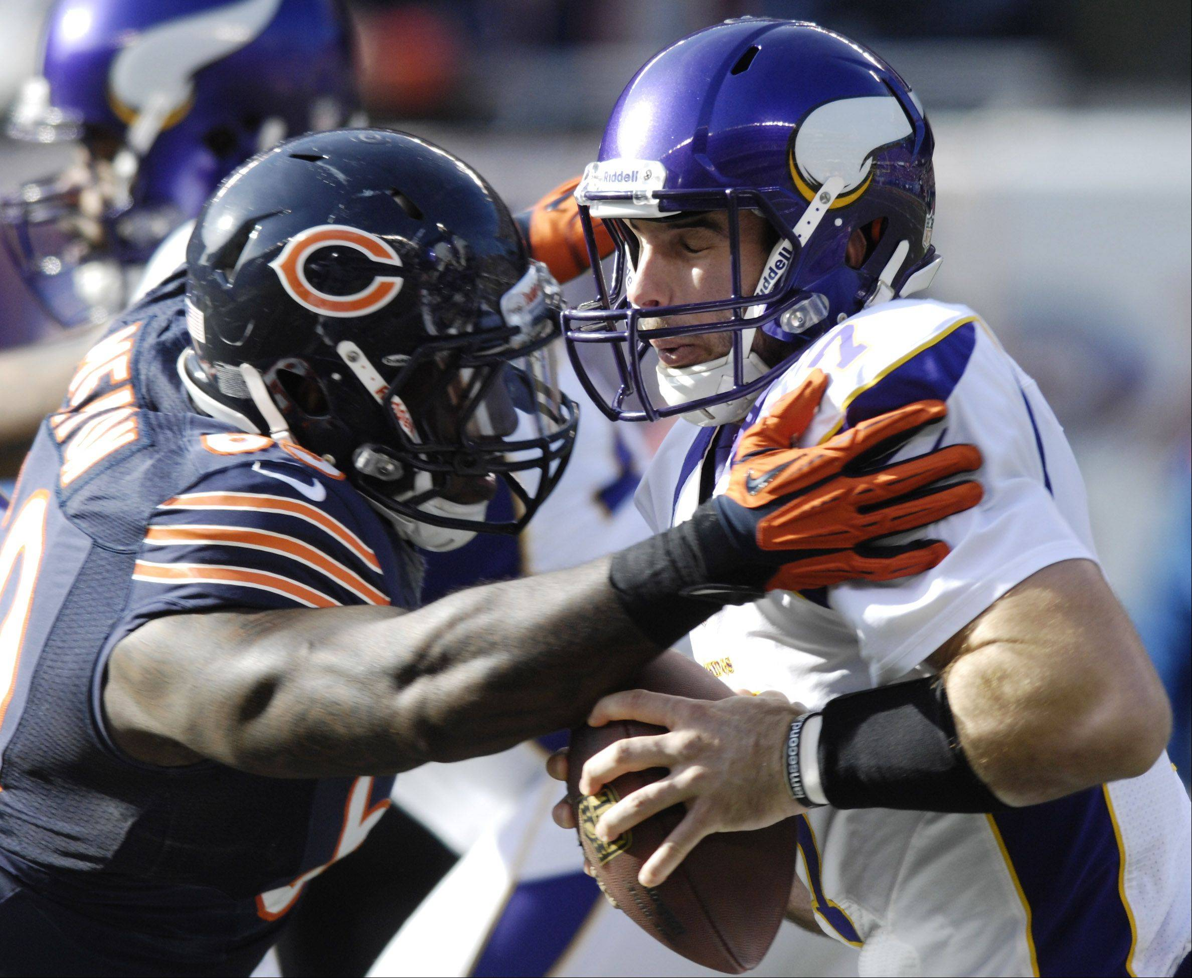 Chicago Bears defensive tackle Henry Melton sacks Minnesota Vikings quarterback Christian Ponder on the first play of the game at Soldier Field Sunday.