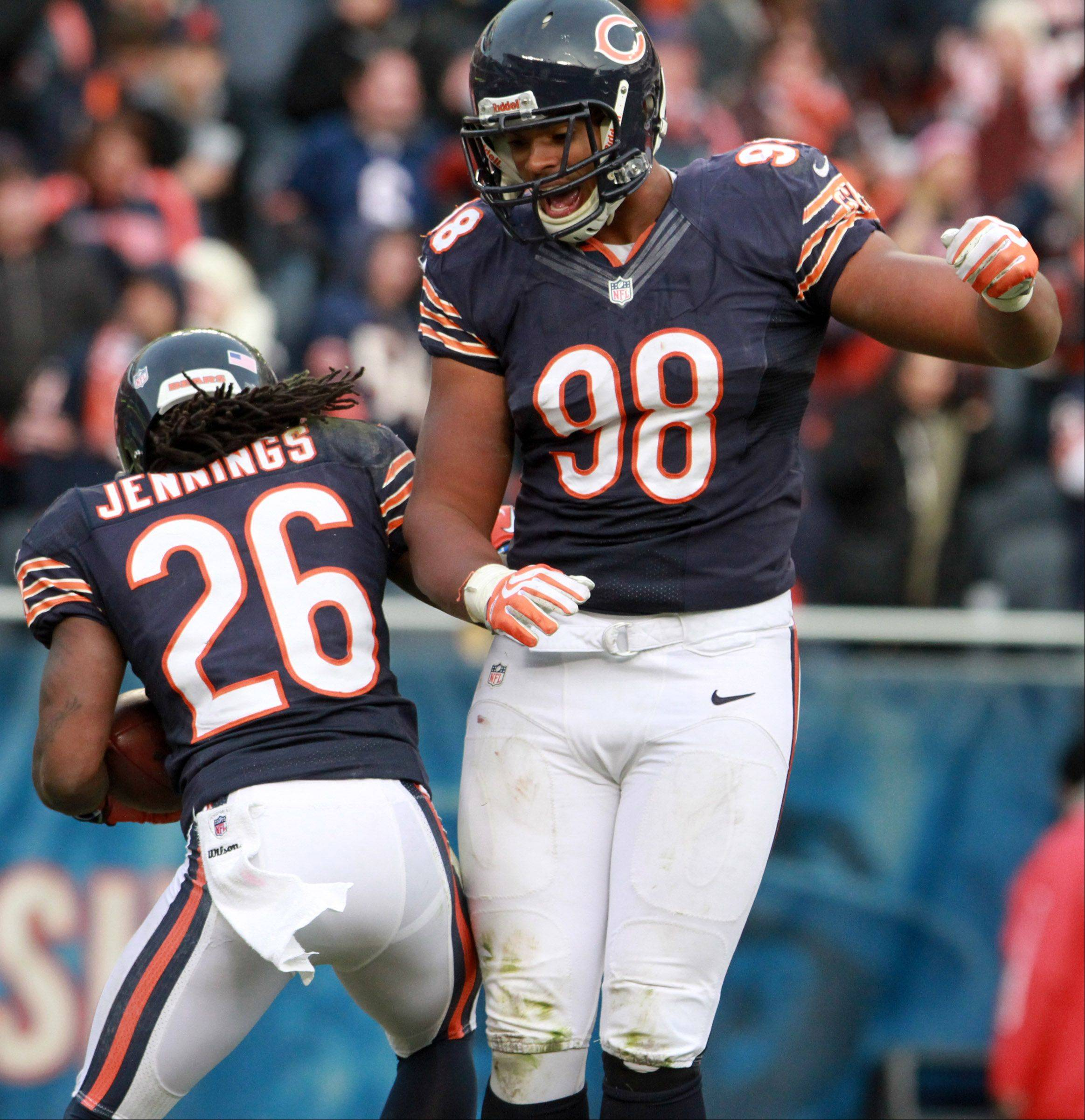 Chicago Bears cornerback Tim Jennings celebrates an intercepting with Corey Wootton at Soldier Field Sunday.