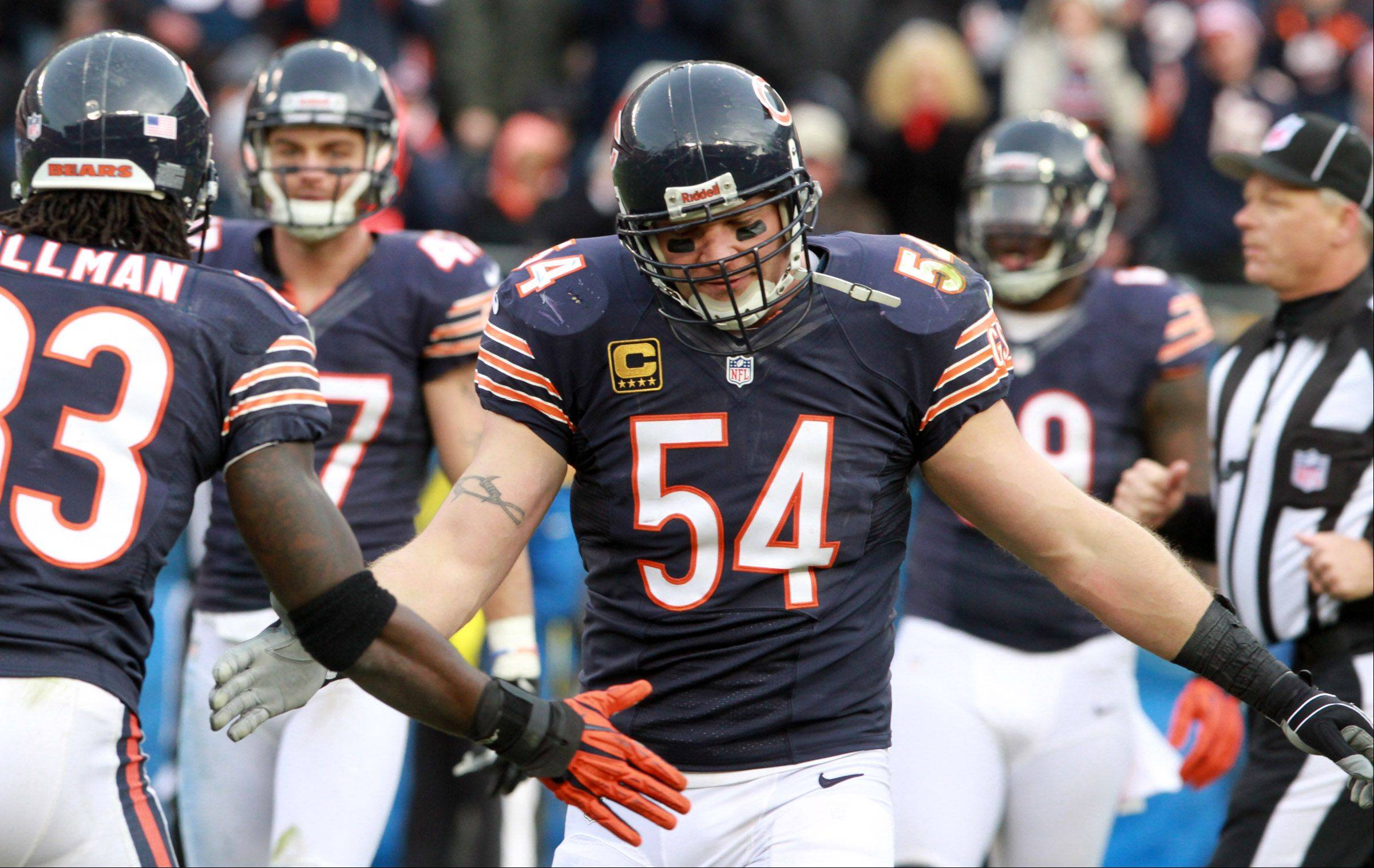 Chicago Bears cornerback Charles Tillman and linebacker Brian Urlacher celebrate a third-down defensive stop against the Vikings at Soldier Field Sunday.