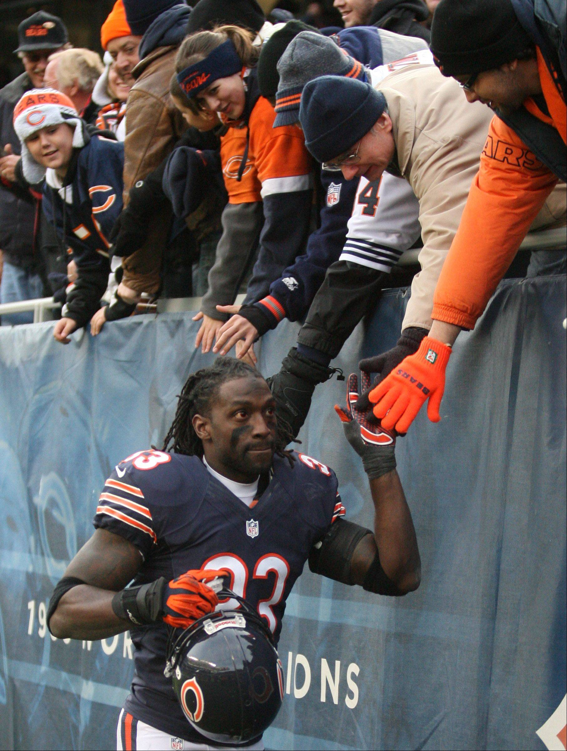 Chicago Bears cornerback Charles Tillman celebrates with fans after winning over the Minnesota Vikings at Soldier Field Sunday.