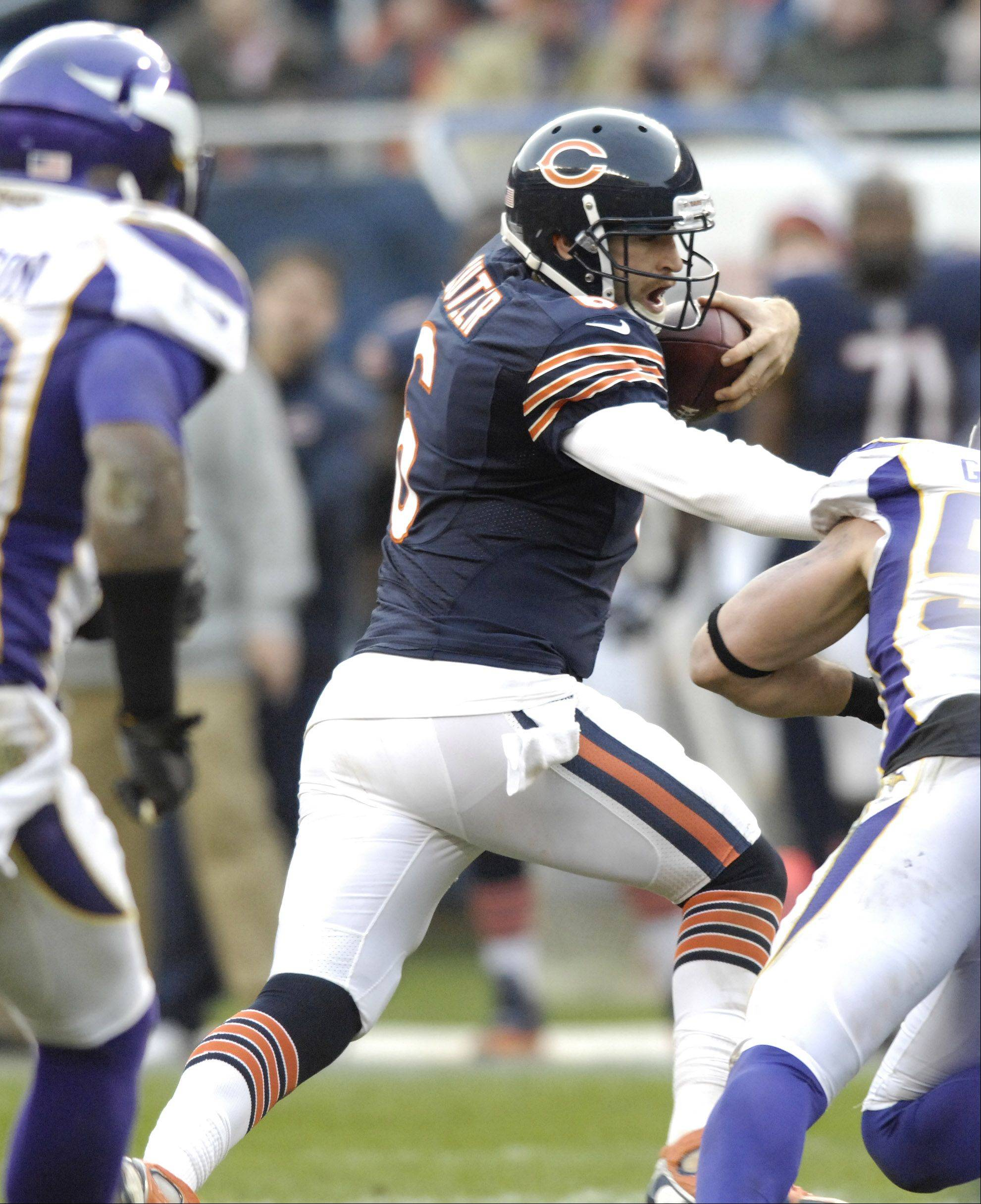 Chicago Bears quarterback Jay Cutler carries the ball against the Minnesota Vikings at Soldier Field Sunday.