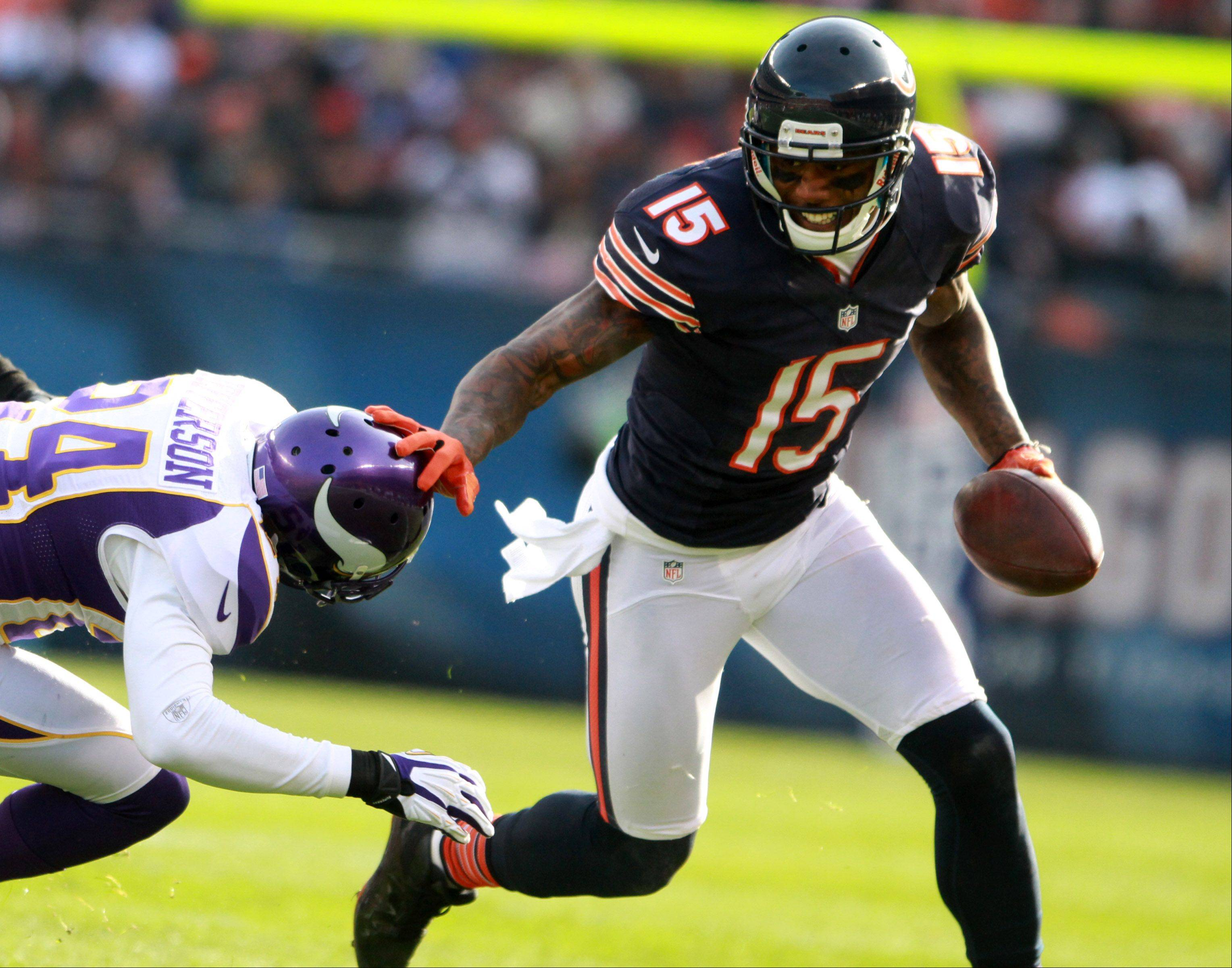 Chicago Bears wide receiver Brandon Marshall fights off Minnesota Vikings cornerback A.J. Jefferson after catching a pass from quarterback Jay Cutler at Soldier Field Sunday.