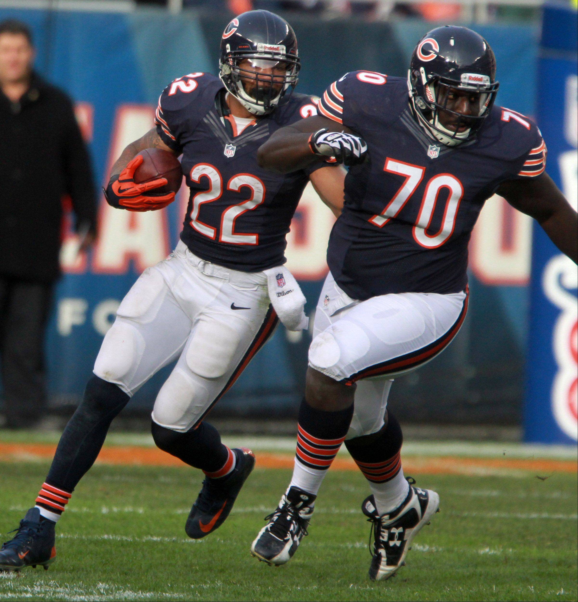Chicago Bears running back Matt Forte runs the ball behind center Edwin Williams at Soldier Field Sunday